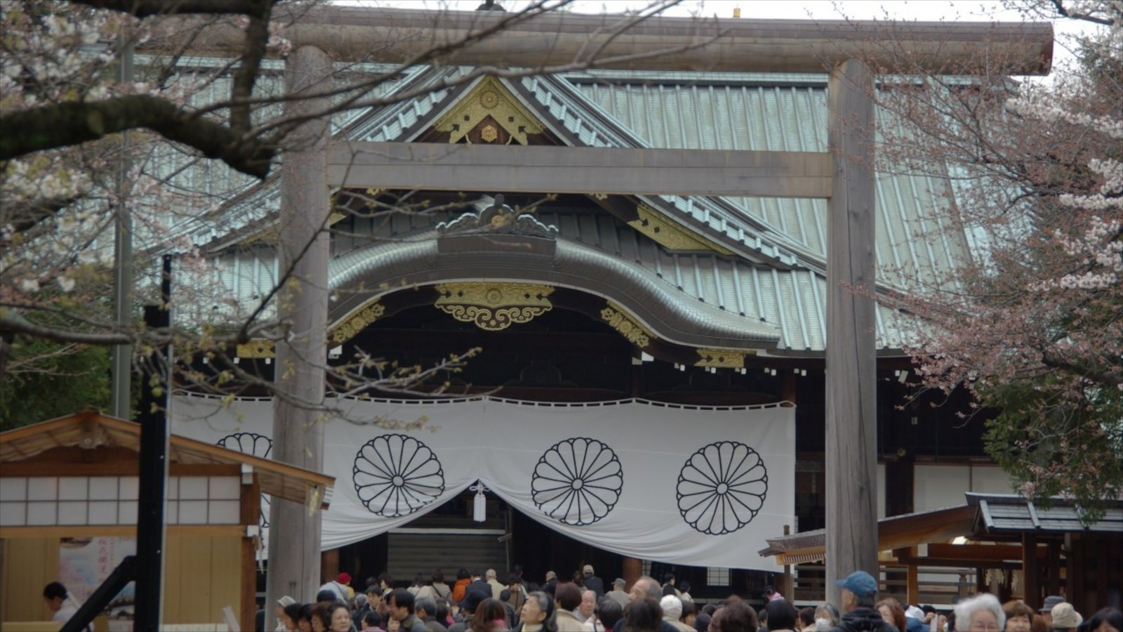 Yasukuni Shrine featuring a temple or place of worship as well as a large group of people