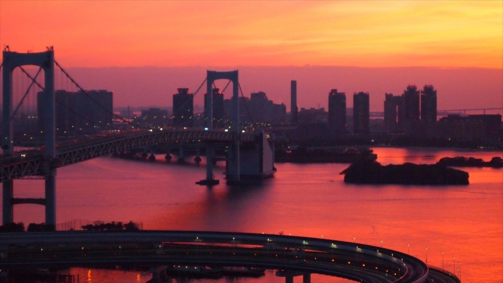 Rainbow Bridge featuring a city, a sunset and a bridge