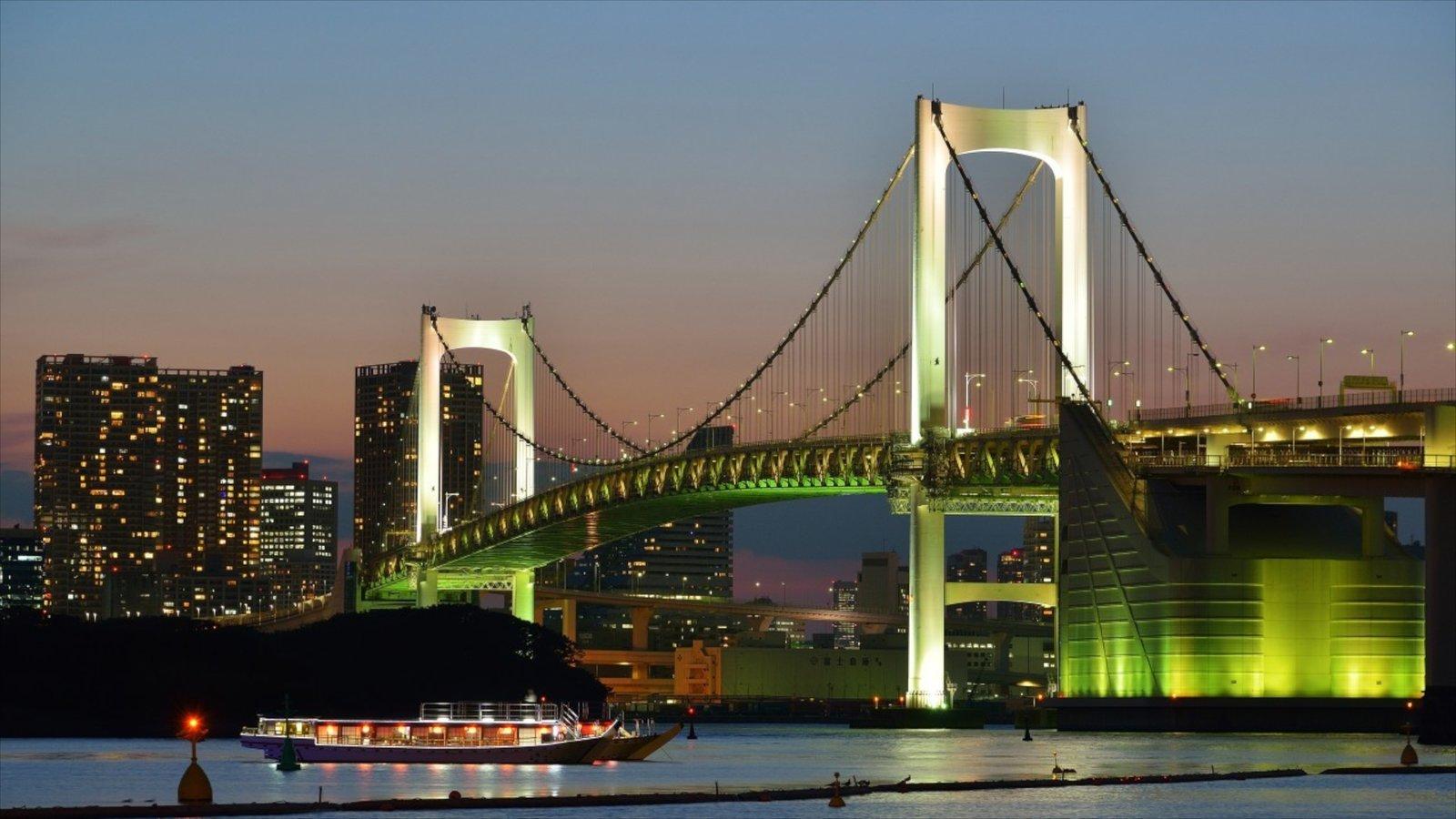 Rainbow Bridge showing a city, general coastal views and night scenes