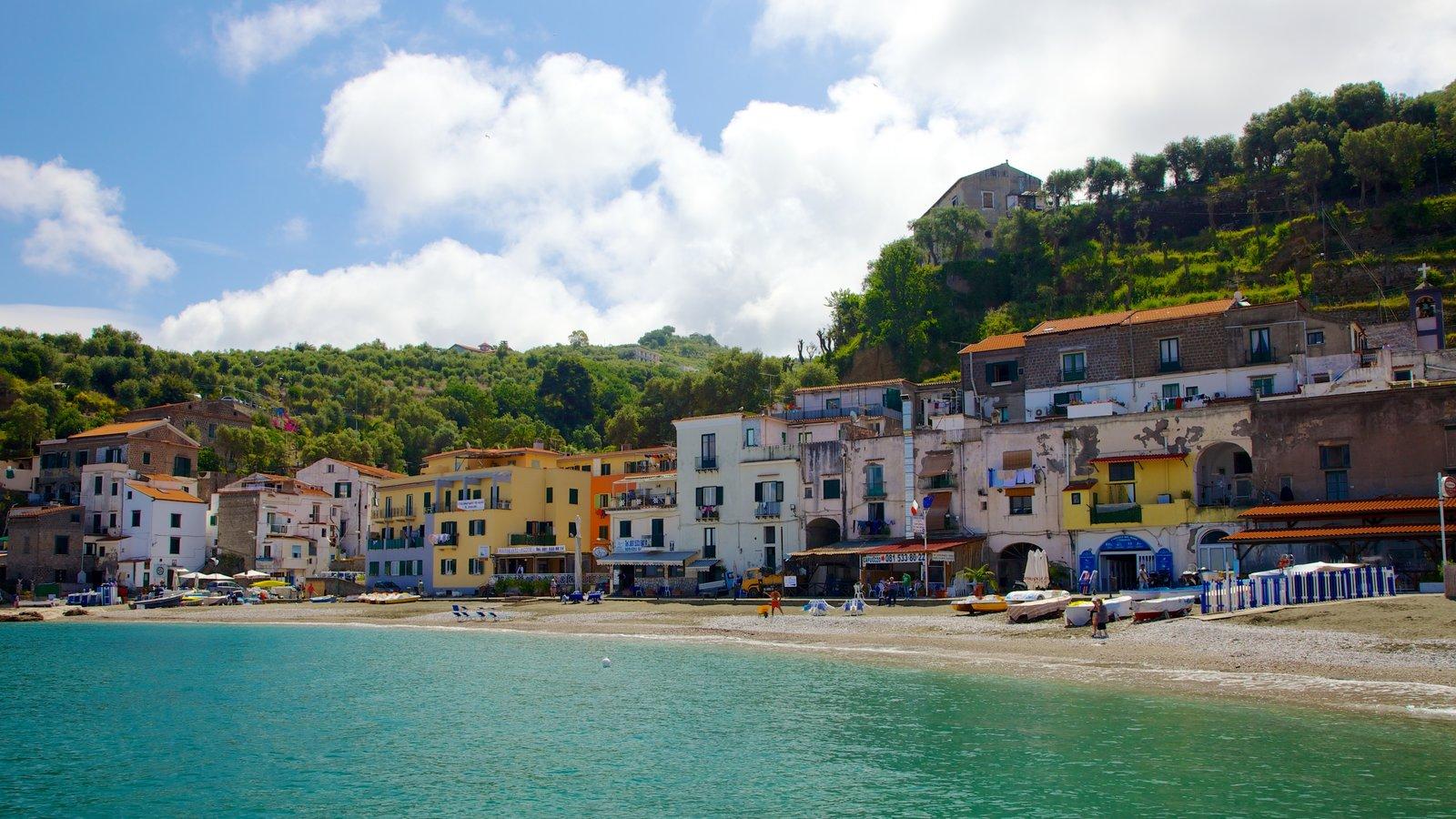 Marina di Puolo showing a sandy beach and a coastal town