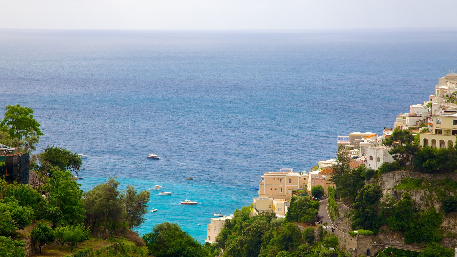 Positano which includes a city, a coastal town and general coastal views