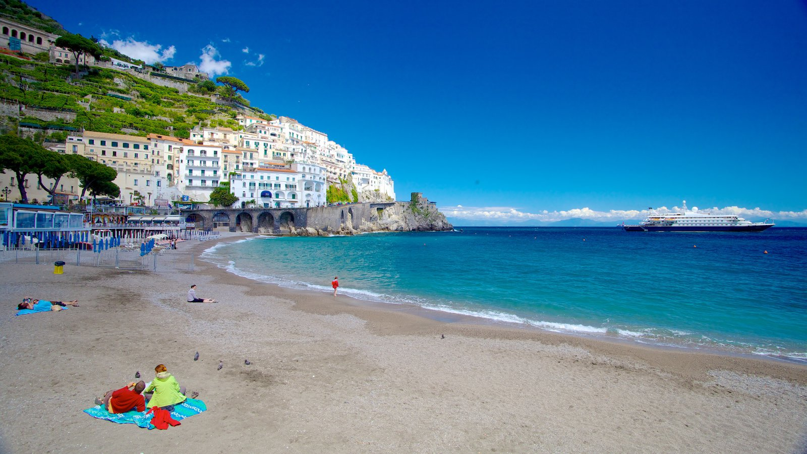 Amalfi showing a coastal town, a bay or harbor and a beach
