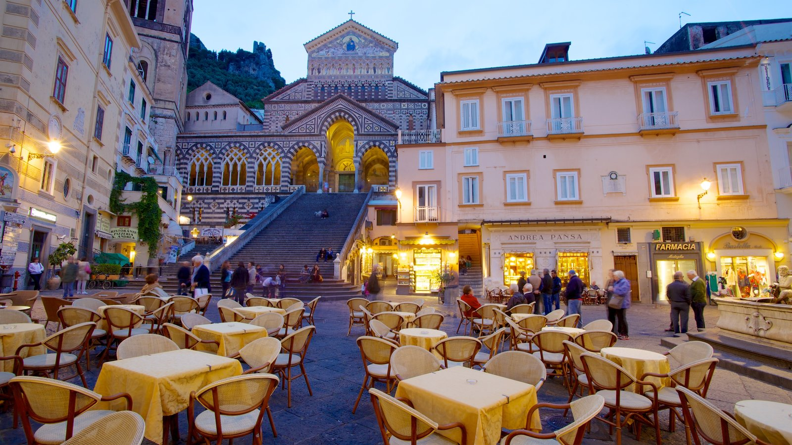 Amalfi showing night scenes, a city and outdoor eating