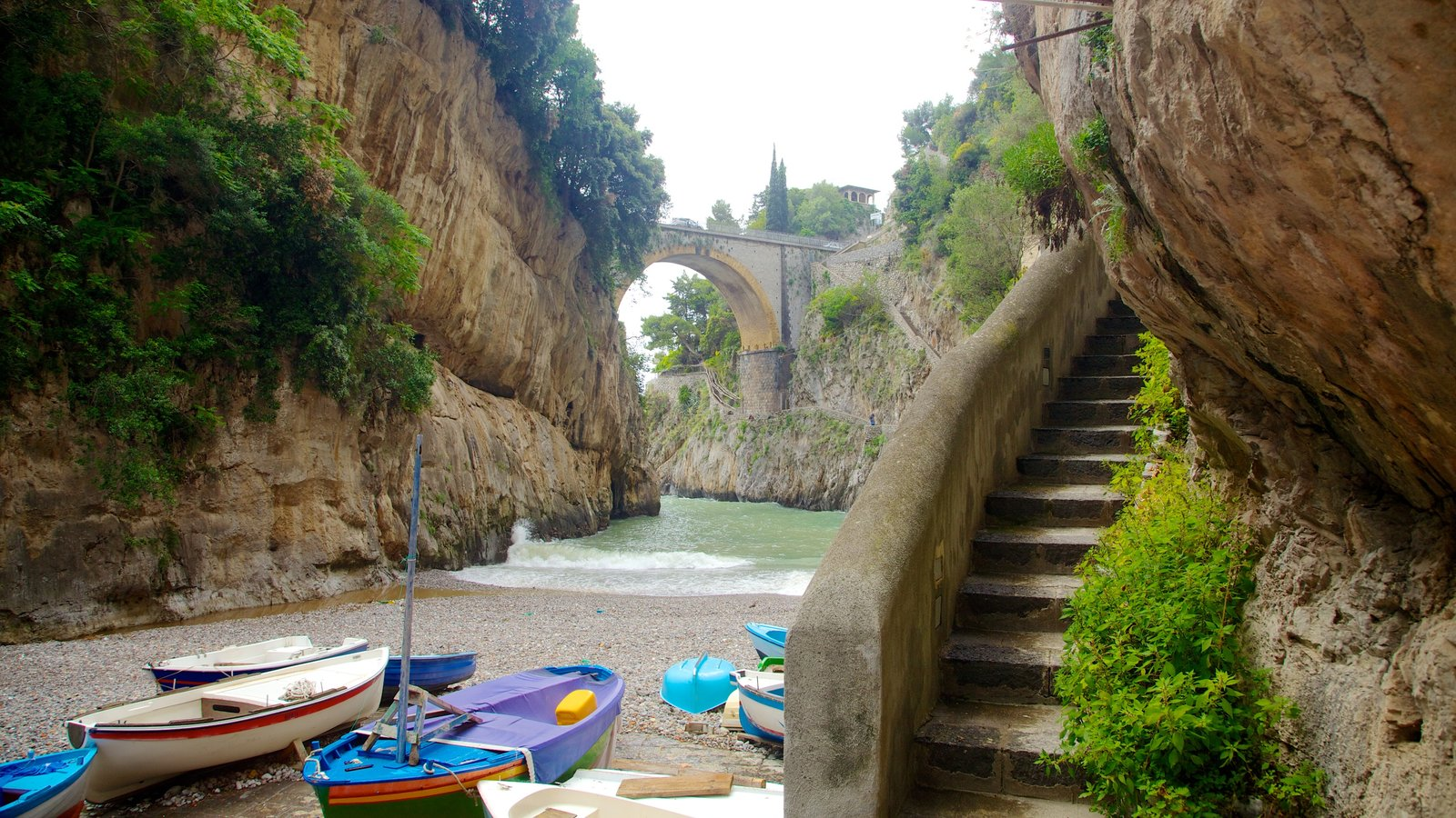 Fiordo di Furore featuring a pebble beach and boating