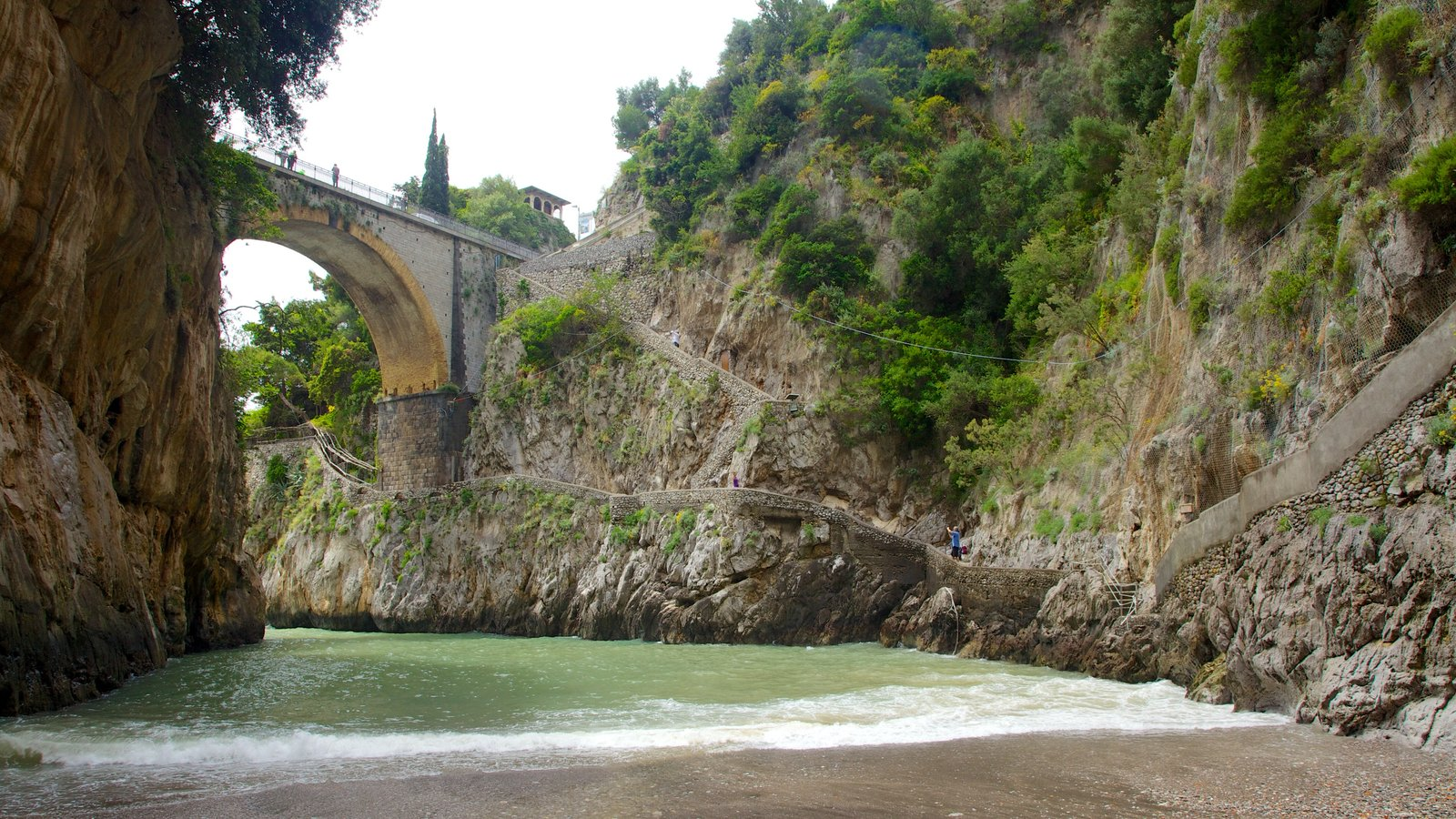 Fiordo di Furore showing a beach and a bridge
