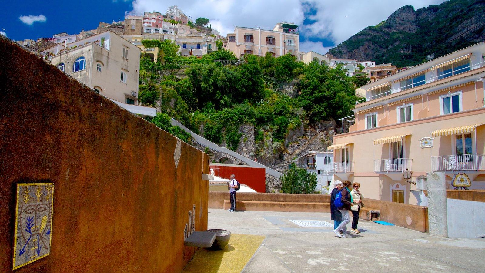 Church of Santa Maria Assunta which includes a square or plaza and street scenes