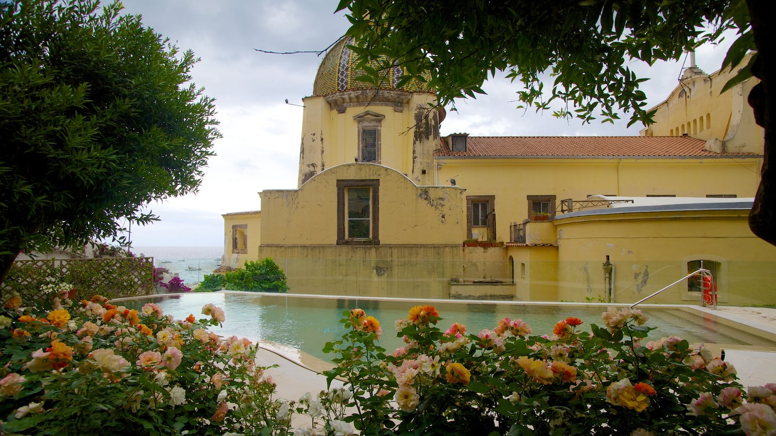 Church of Santa Maria Assunta which includes flowers and a pool