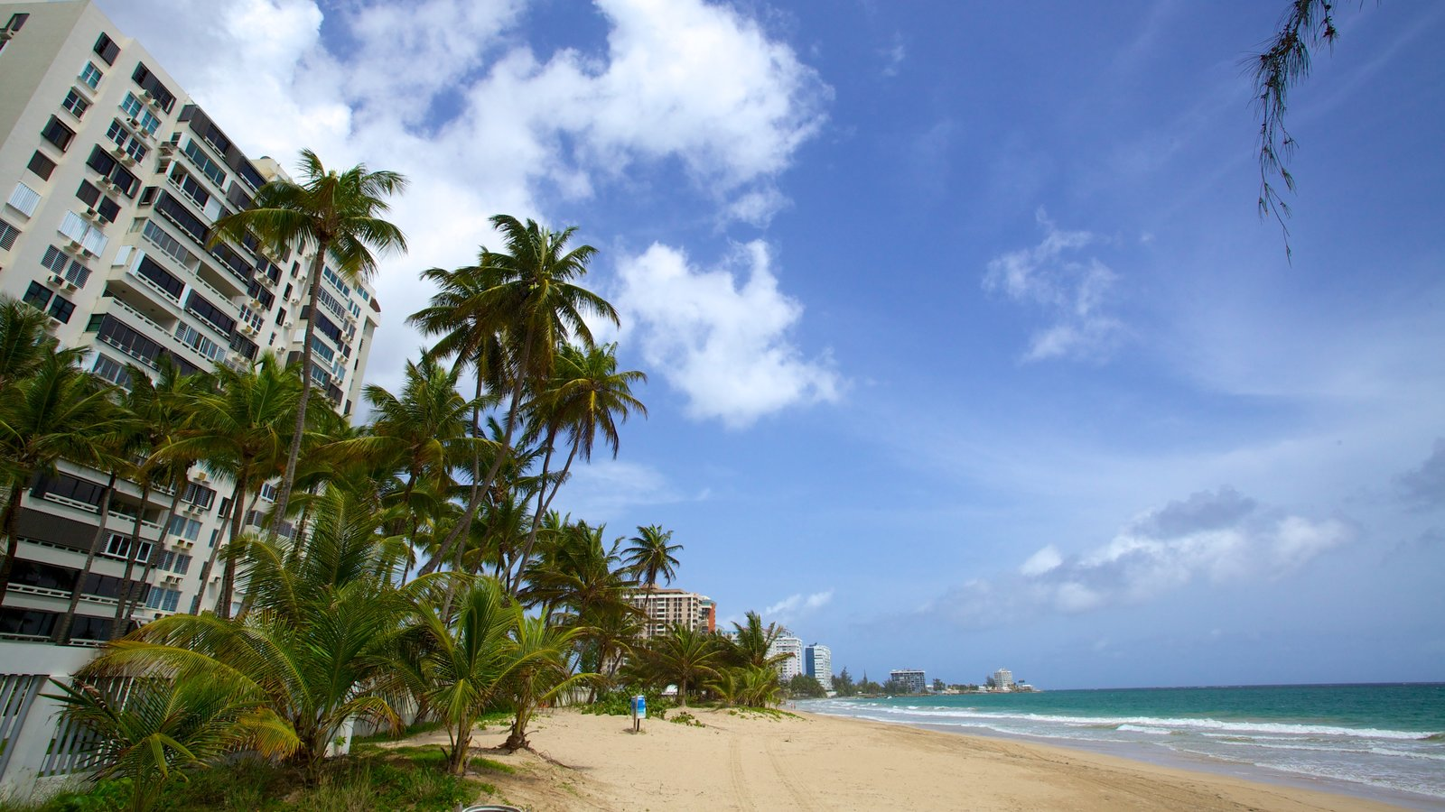 Isla Verde Beach which includes a hotel, a coastal town and a beach