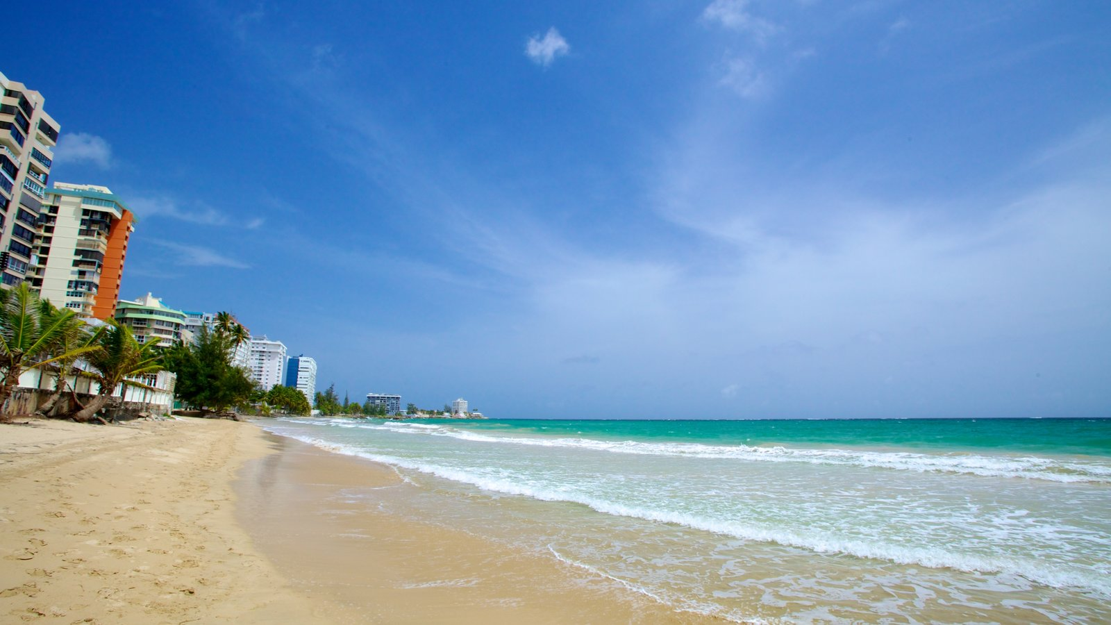 Isla Verde Beach showing a beach and a coastal town