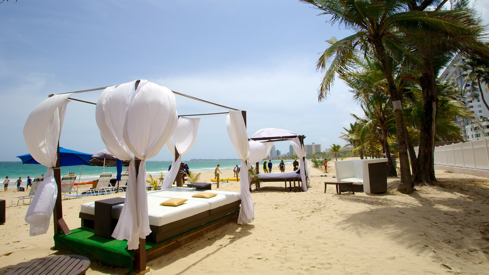 Isla Verde Beach Showing A Sandy Tropical Scenes And Luxury Hotel Or Resort