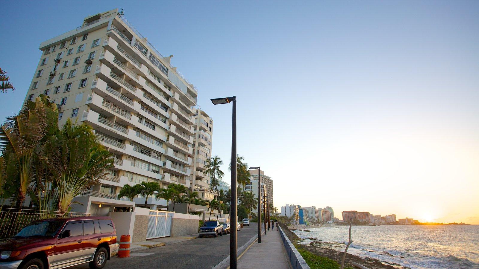 Condado Beach which includes general coastal views, street scenes and a coastal town
