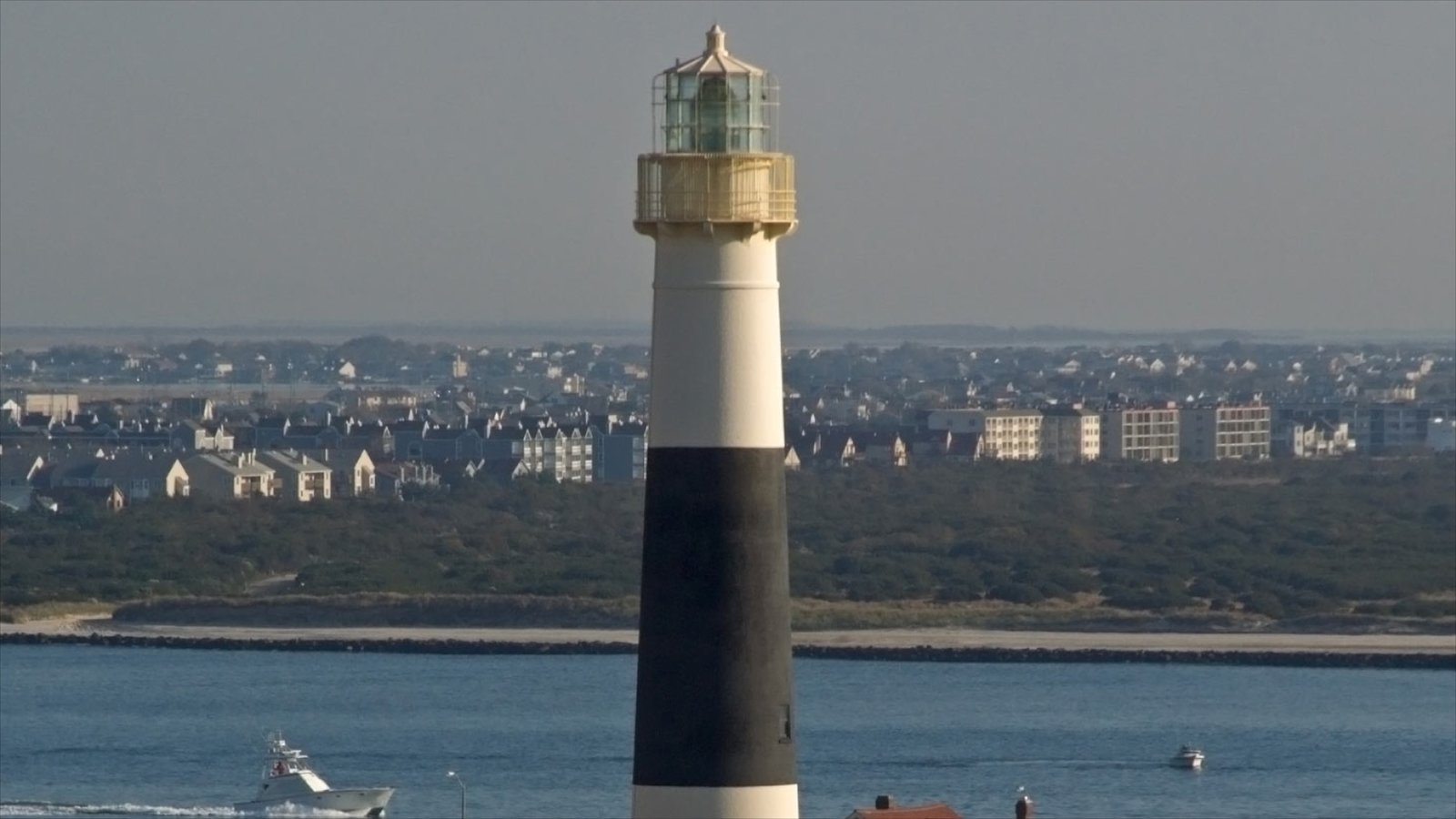 Absecon Lighthouse which includes a lighthouse and general coastal views