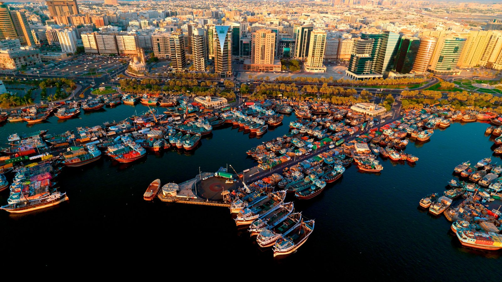Dubai Creek showing boating, a marina and cbd
