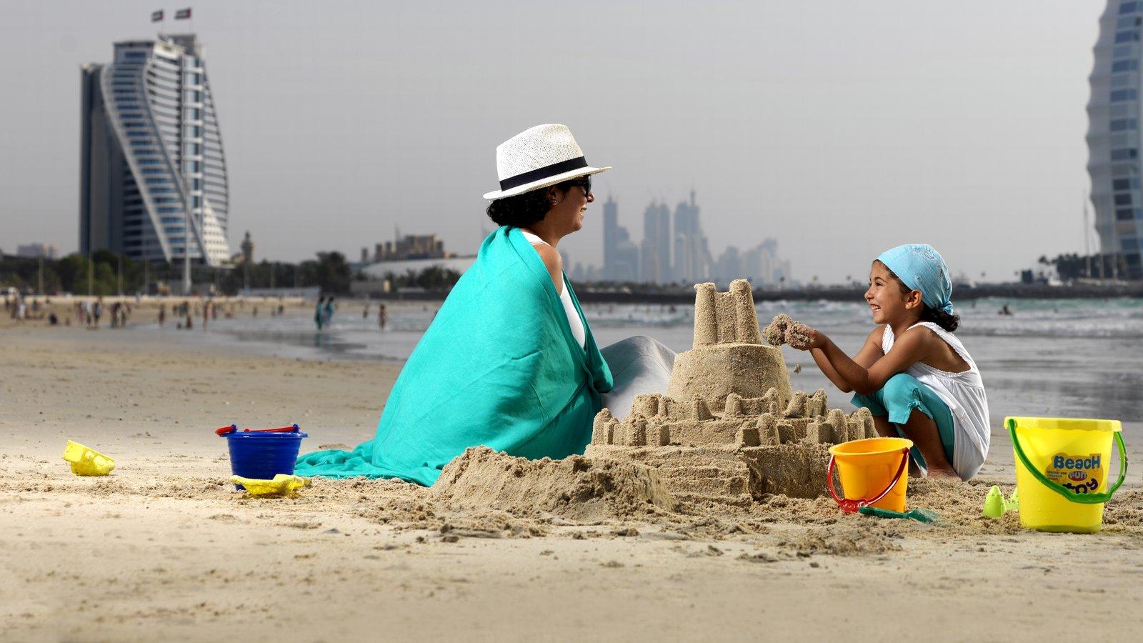 Jumeira Beach and Park which includes a beach as well as a family