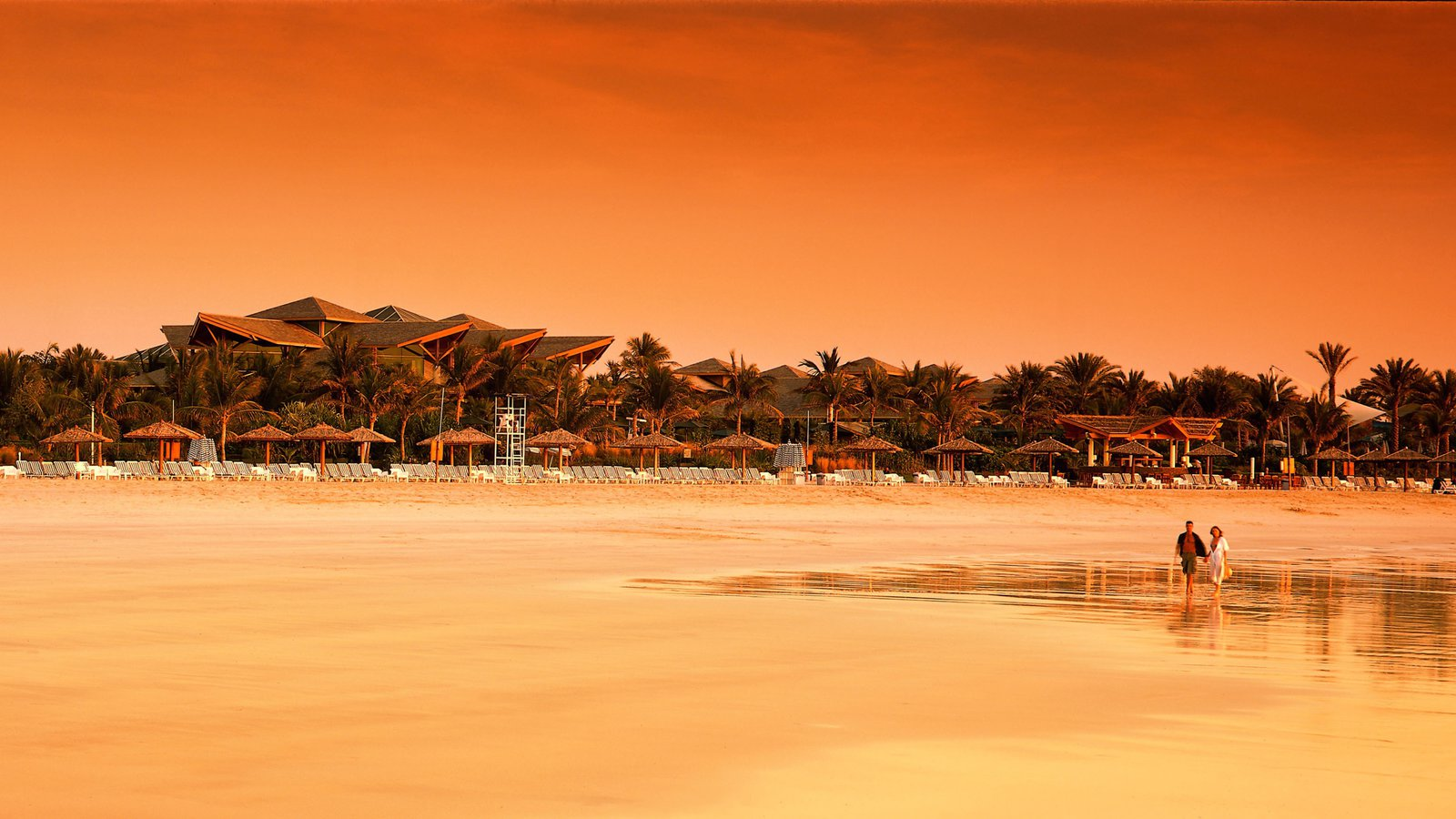 Jumeira Beach and Park showing a luxury hotel or resort, a coastal town and a sunset