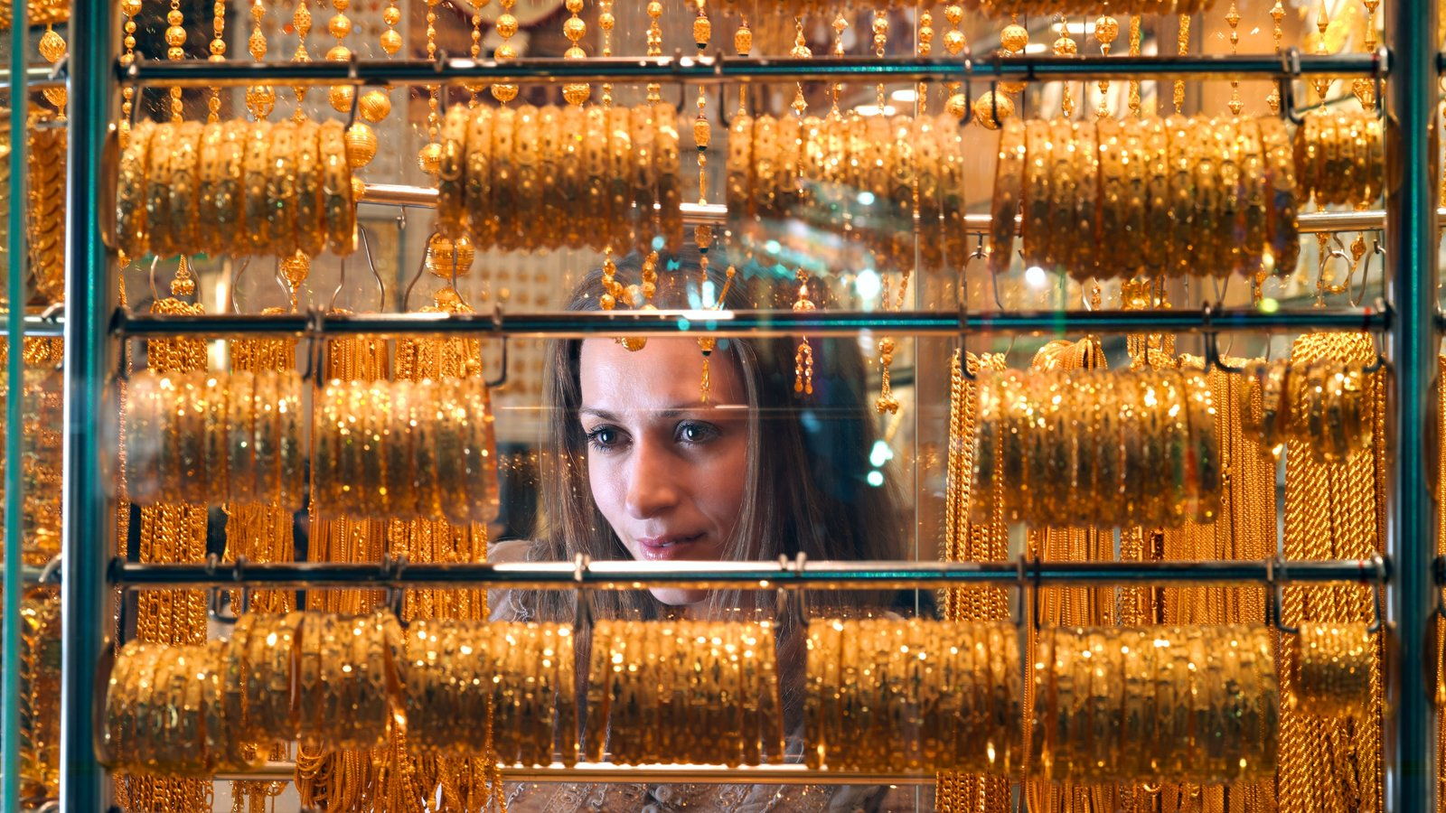 Gold Souk showing shopping and interior views as well as an individual femail