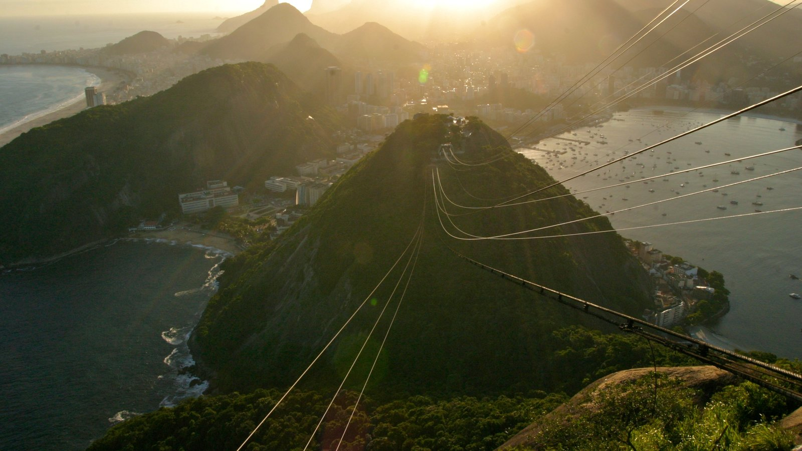 Sugar Loaf Mountain showing a sunset, zip lining and general coastal views