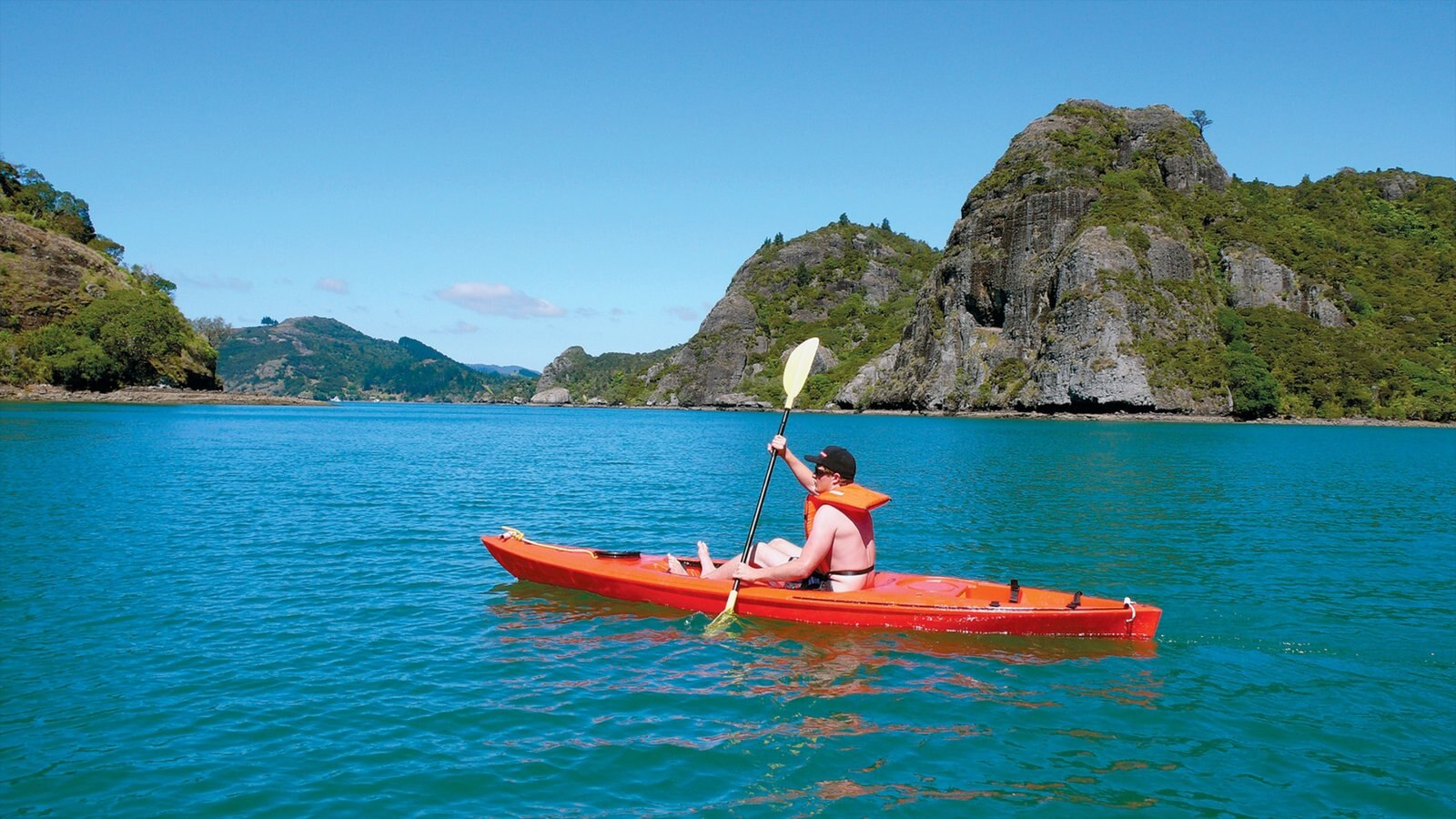 Northland showing island views and kayaking or canoeing as well as an individual male
