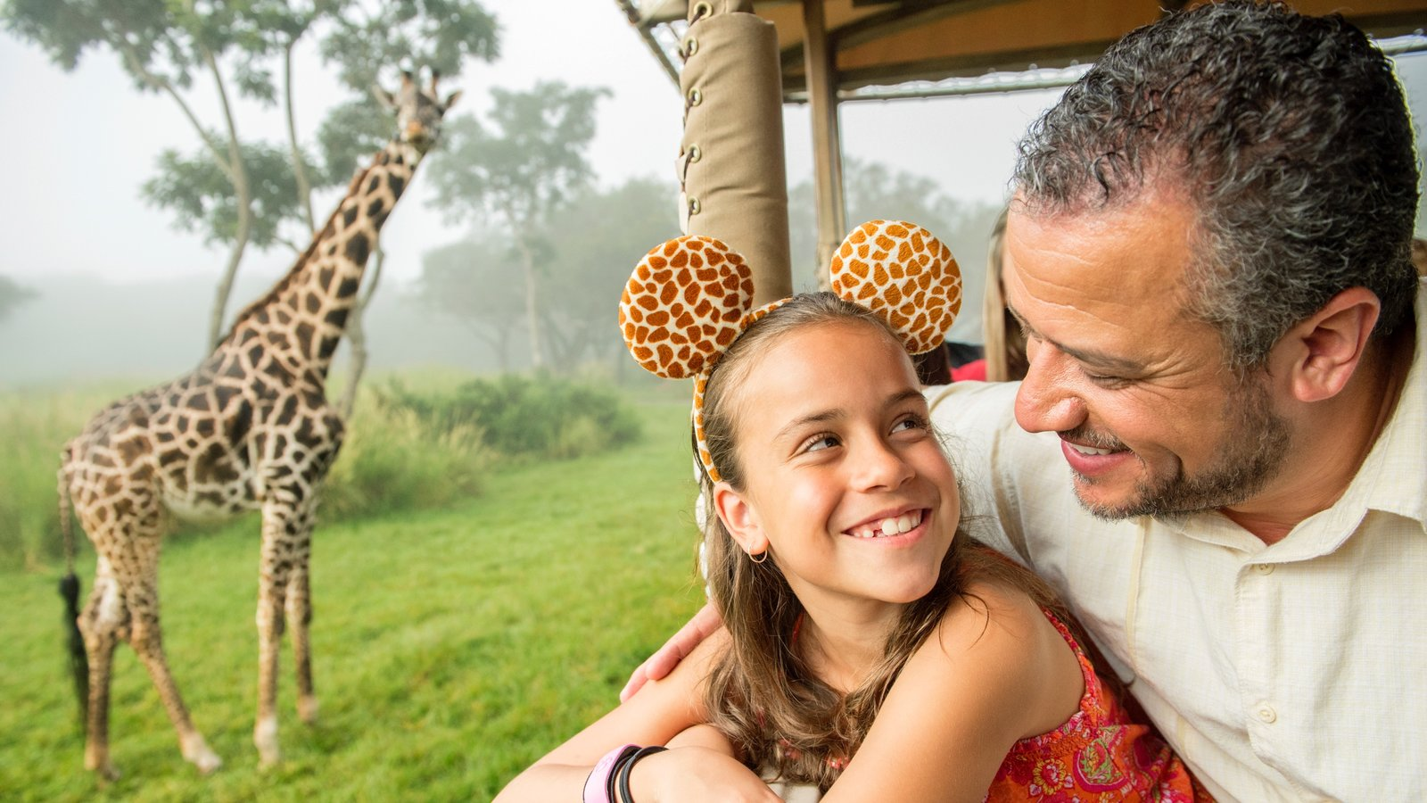 Disney\'s Animal Kingdom® Theme Park showing land animals and safari adventures as well as a family