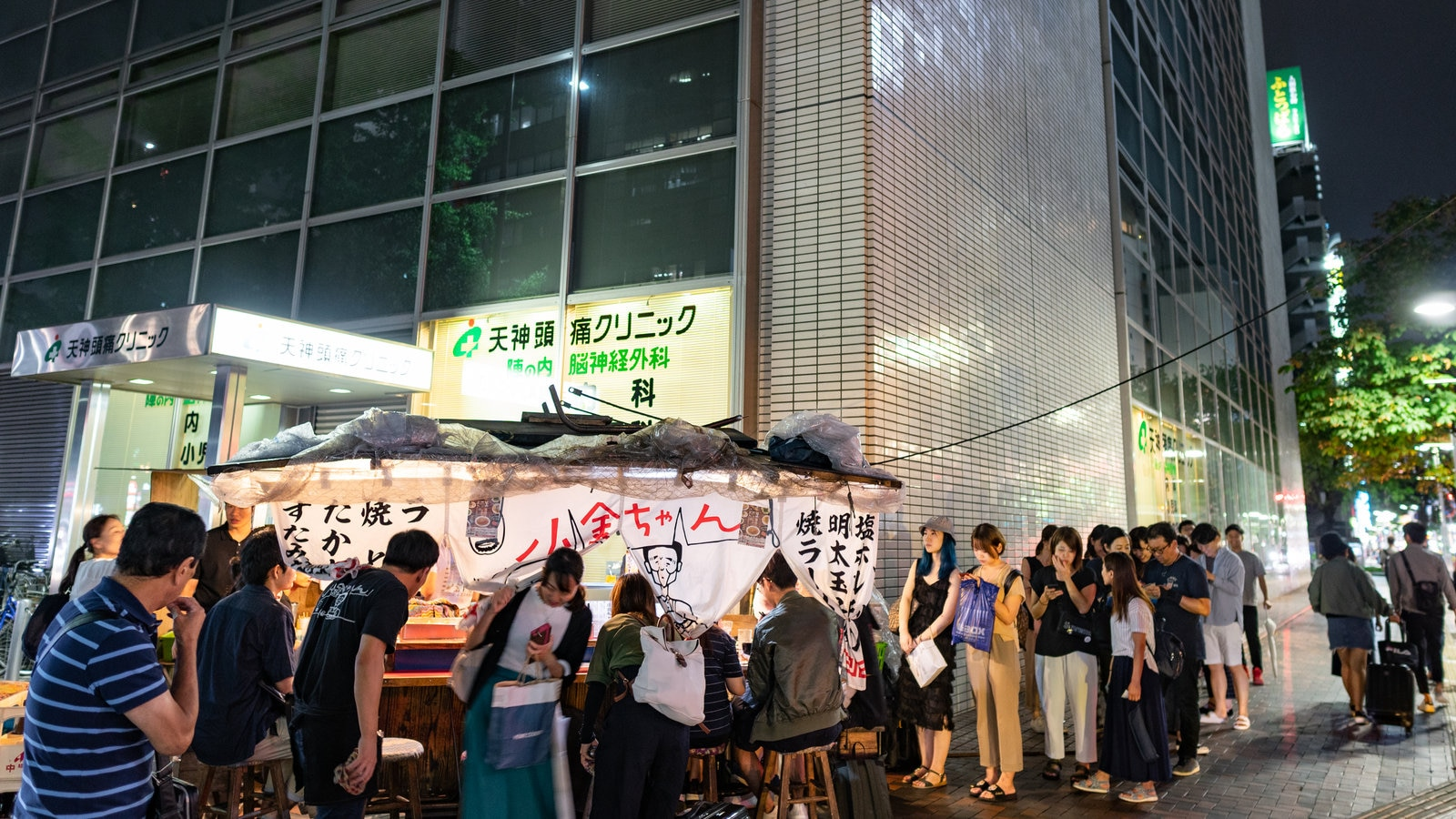 Tenjin which includes street scenes, night scenes and a city