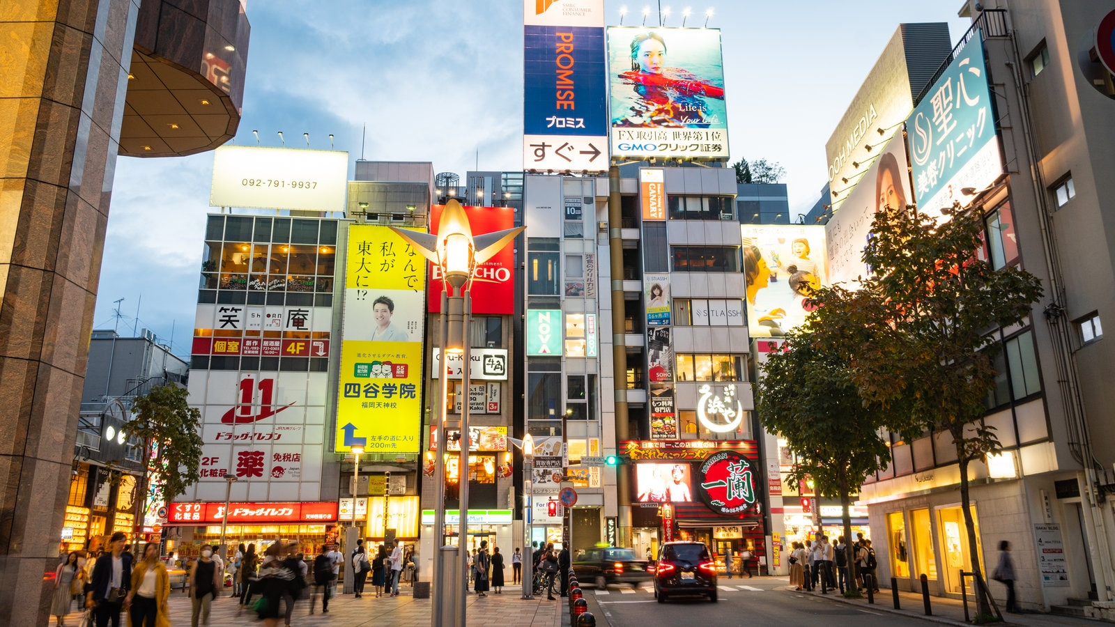 Tenjin which includes street scenes, a sunset and signage