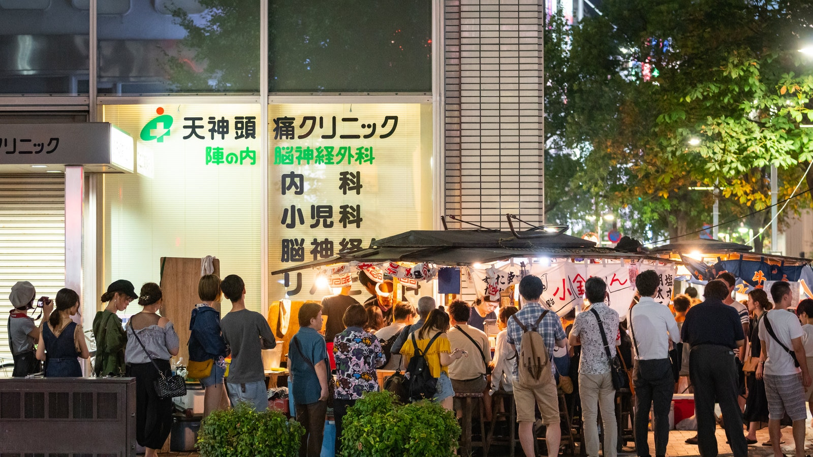 Tenjin featuring street scenes and night scenes as well as a large group of people