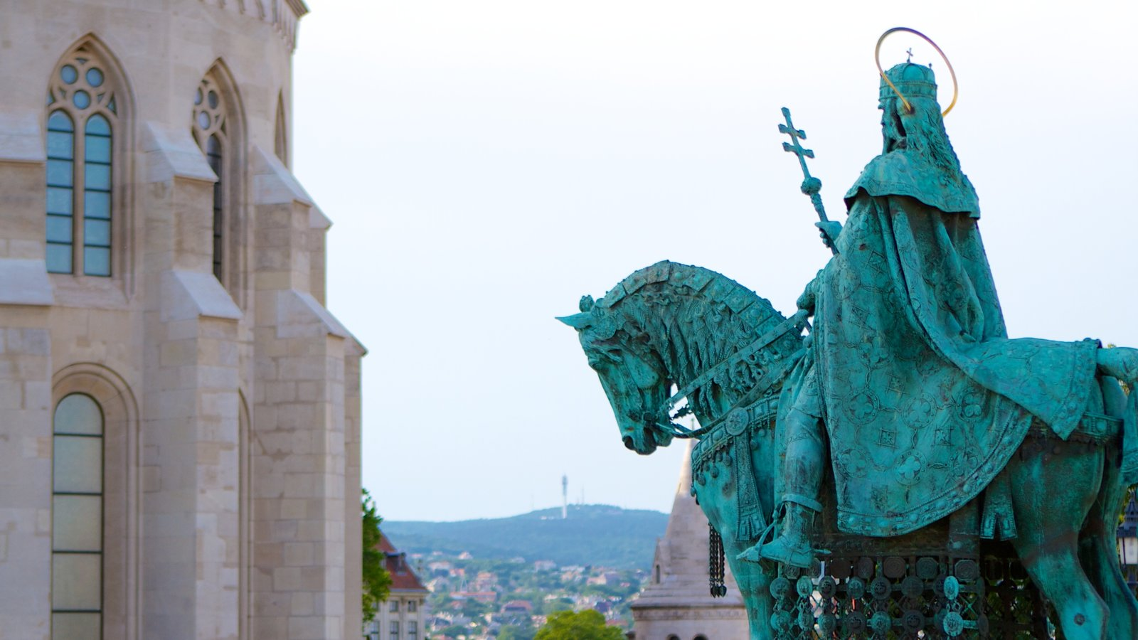 Buda Castle which includes heritage architecture and a statue or sculpture