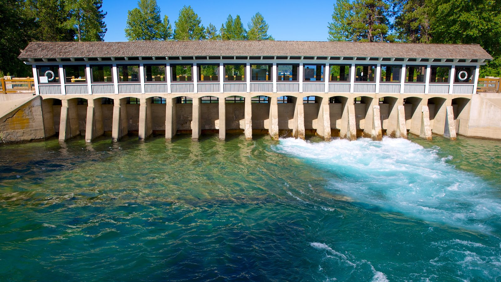 Tahoe City showing a bridge, a lake or waterhole and heritage architecture