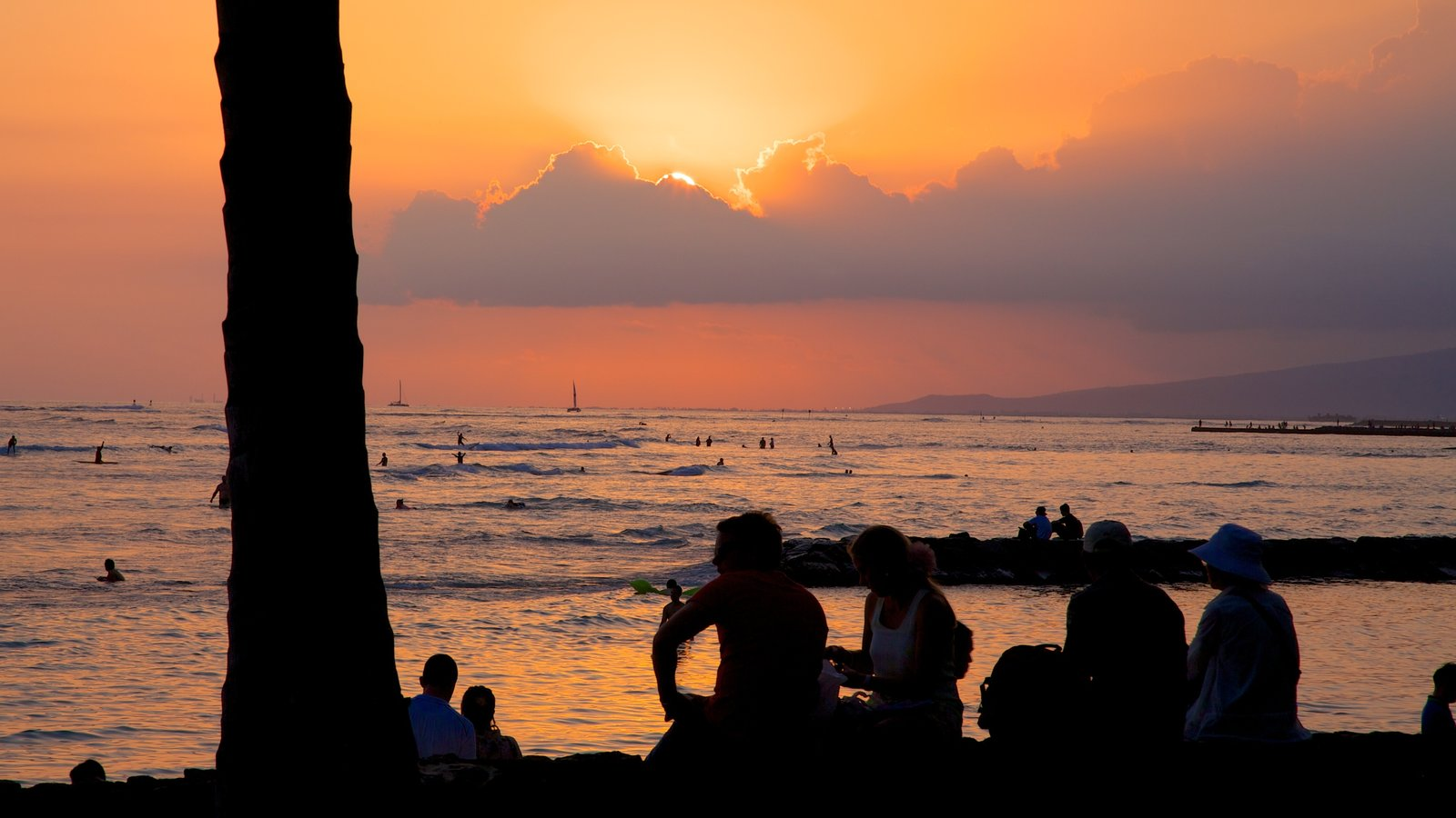 Honolulu which includes general coastal views, a sunset and landscape views