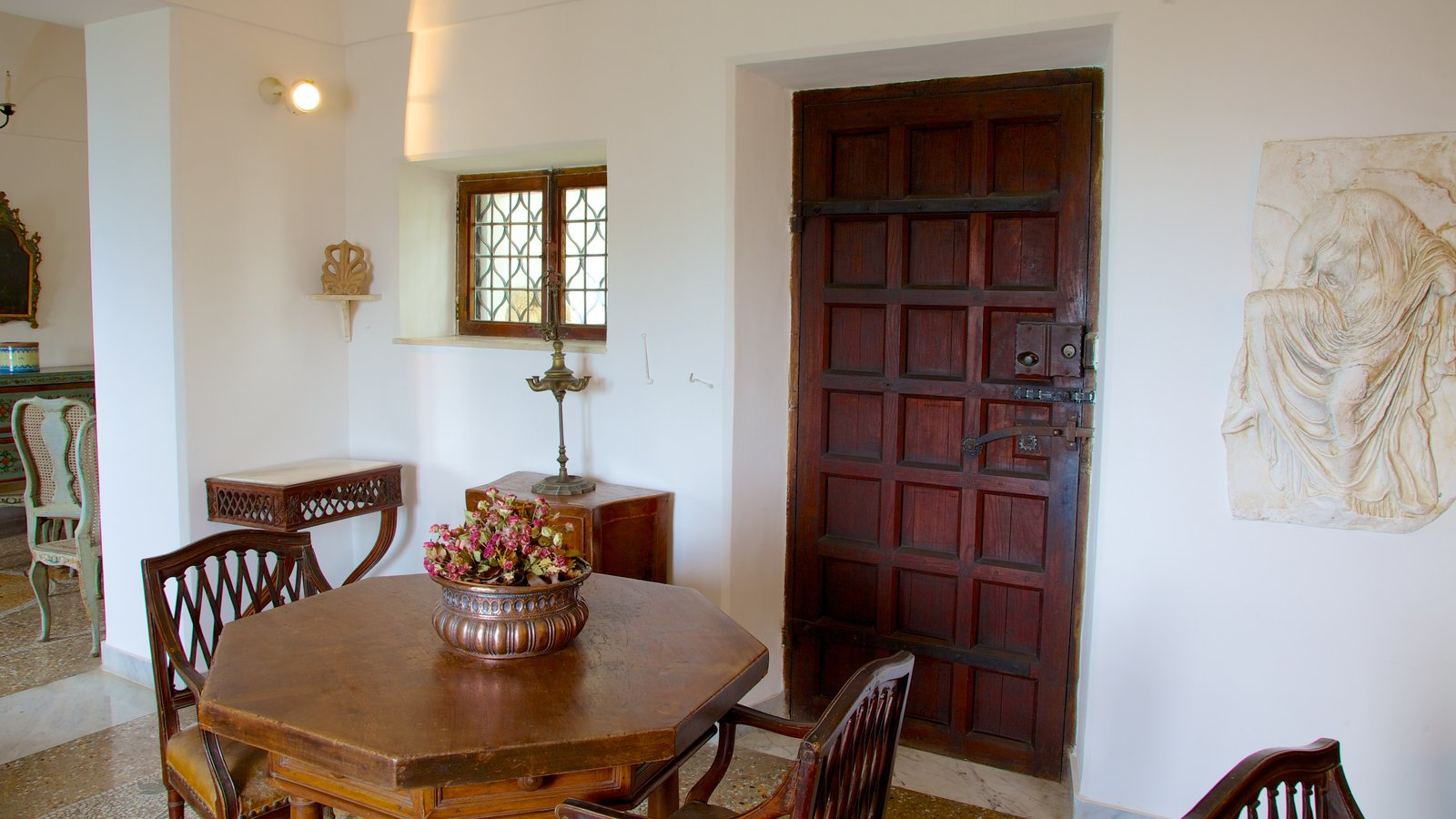 Villa San Michele which includes flowers, a house and interior views