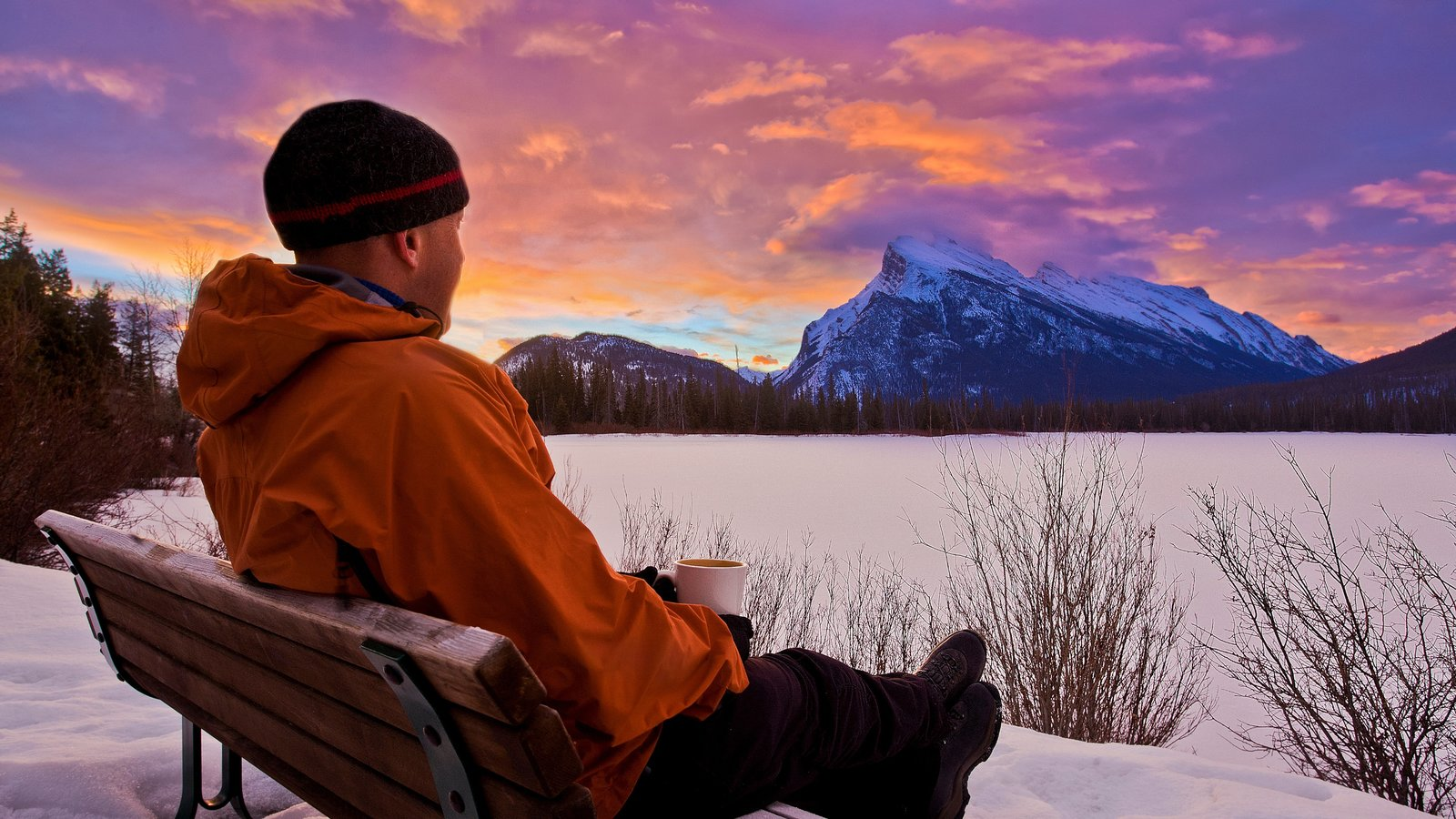 Banff showing a sunset, snow and mountains