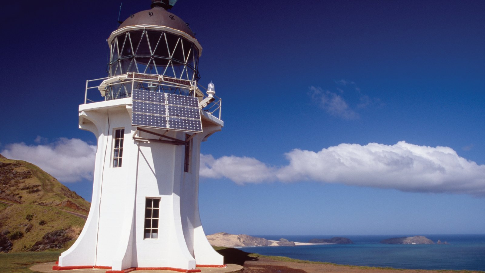 Cape Reinga Lighthouse featuring heritage architecture, general coastal views and a lighthouse
