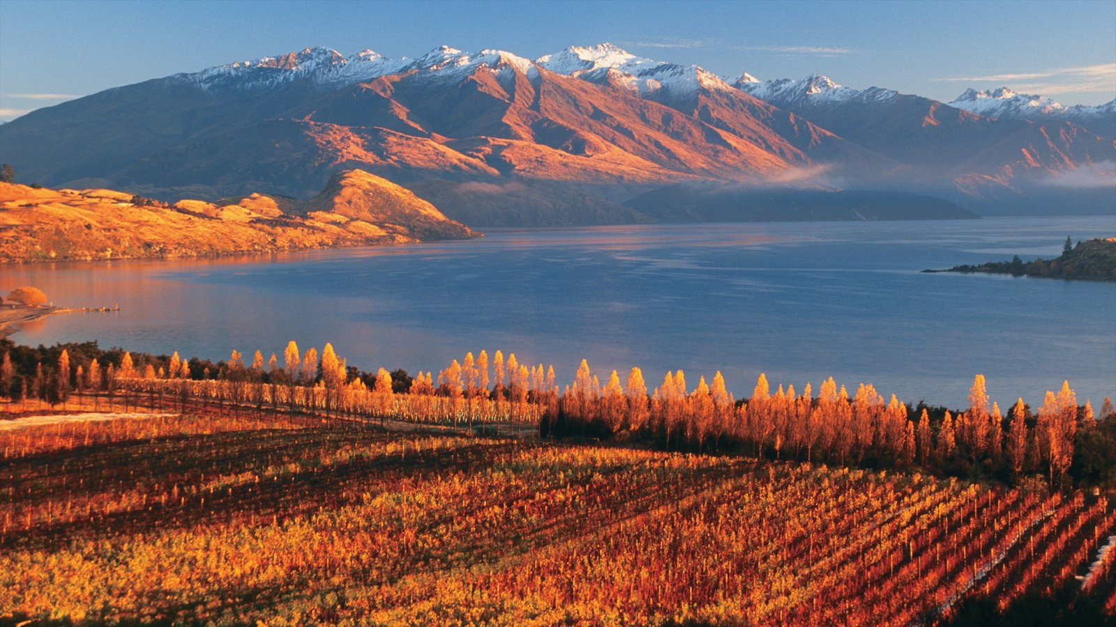 Wanaka which includes a sunset, fall colors and a lake or waterhole