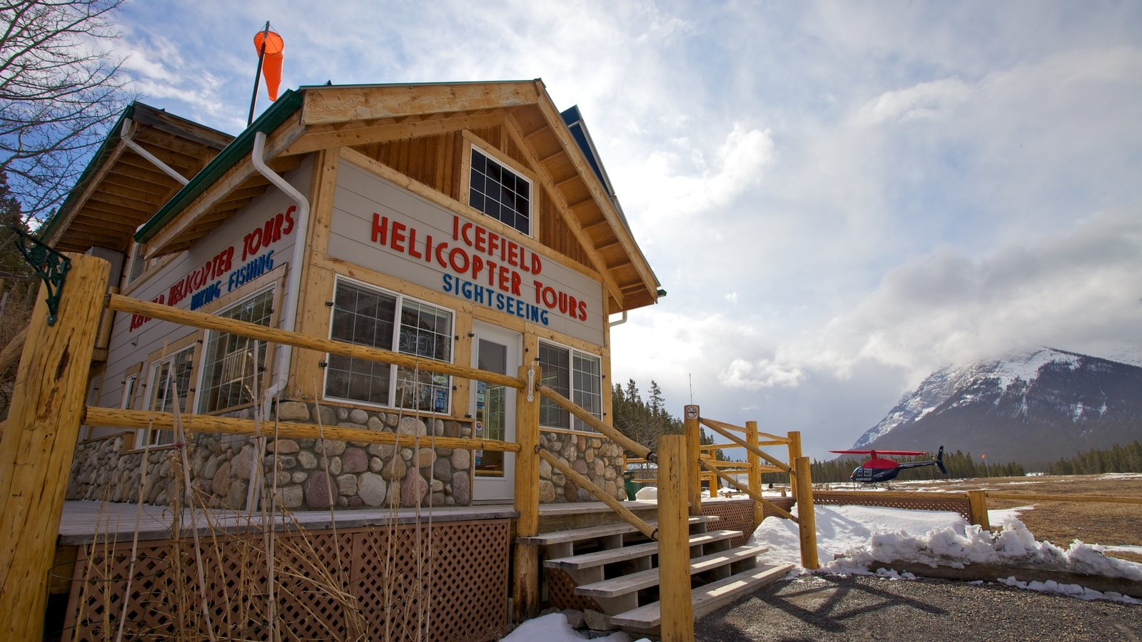 Icefields Parkway featuring snow, signage and aircraft