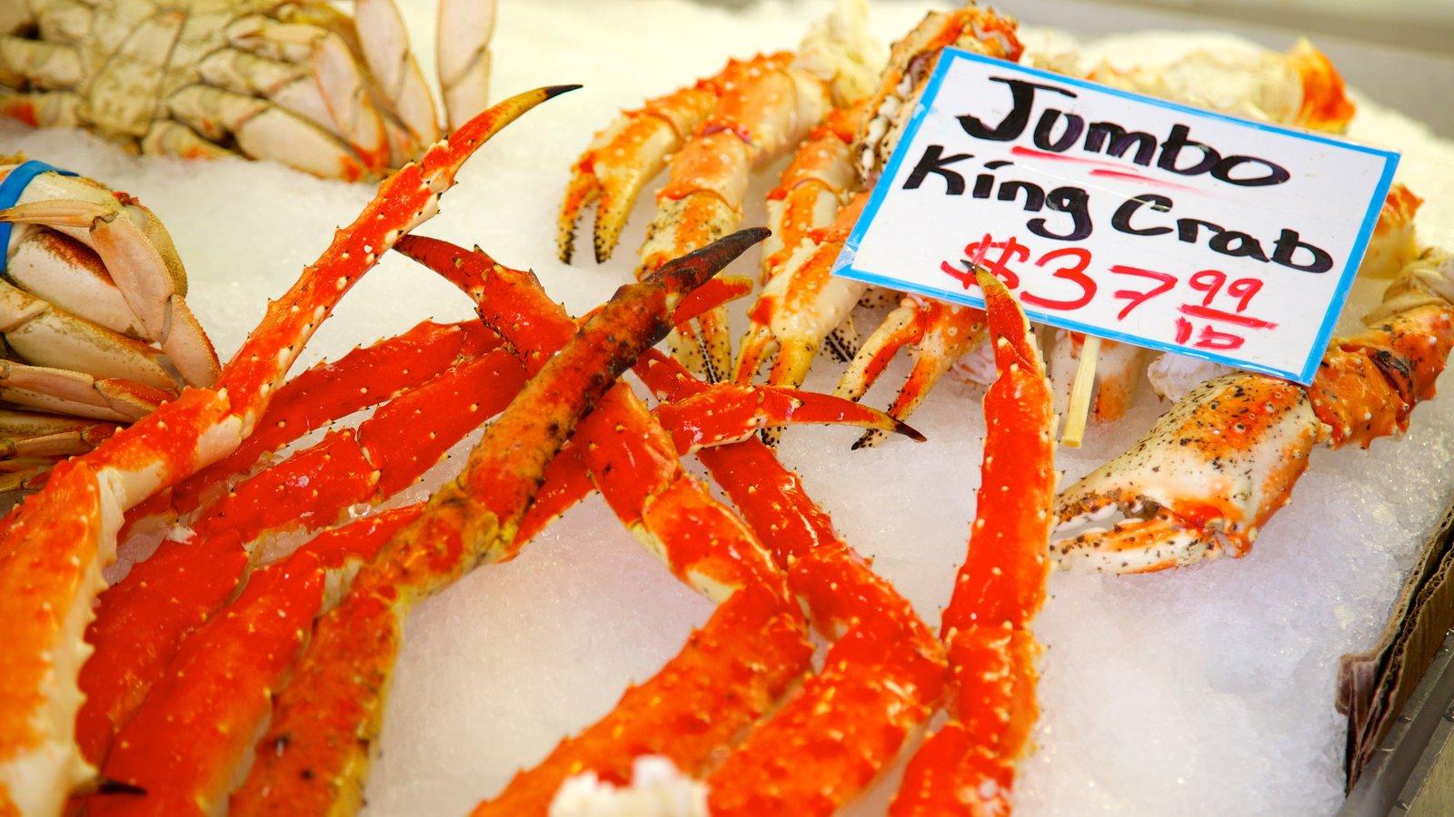 Pike Place Market que incluye comida, señalización y mercados