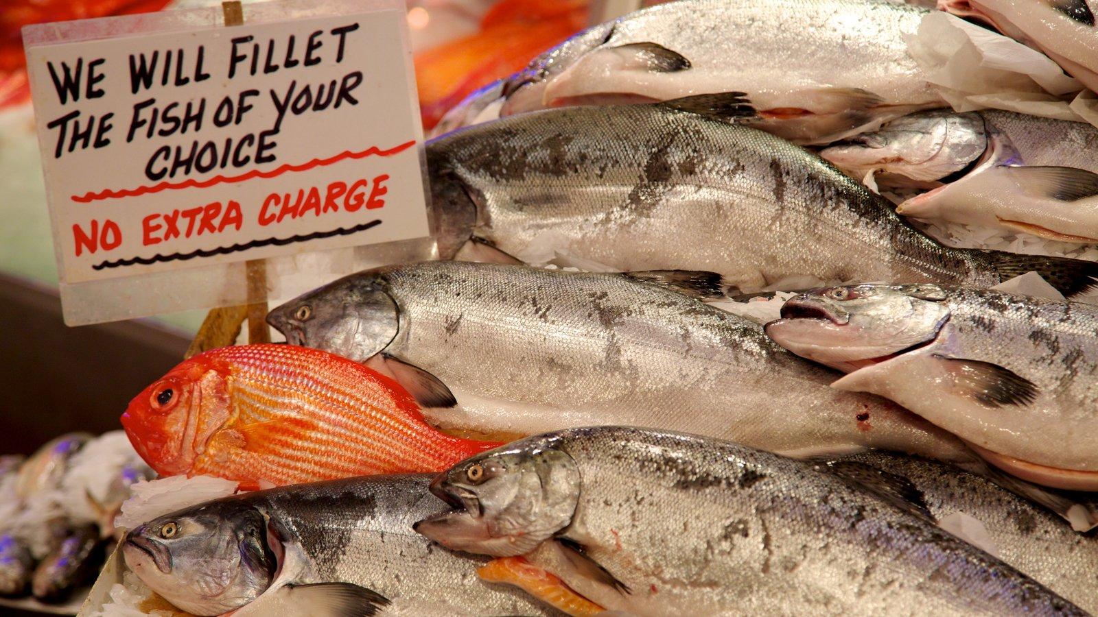 Pike Place Market que incluye señalización, comida y mercados