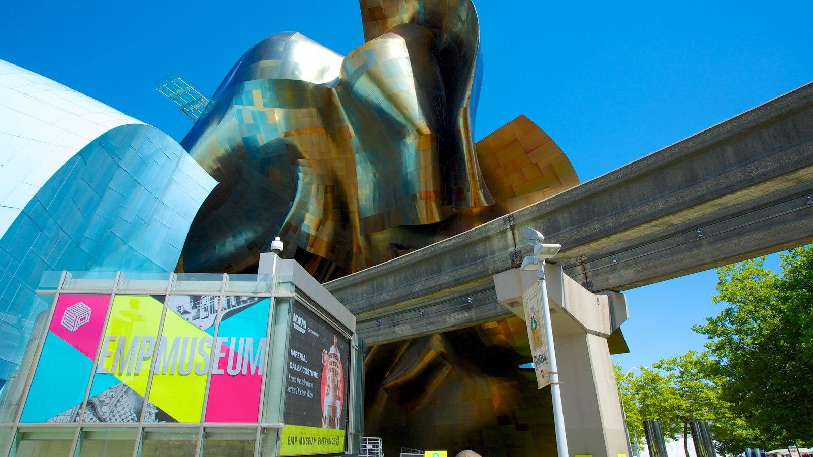 Seattle Center que inclui arquitetura moderna, uma cidade e sinalização