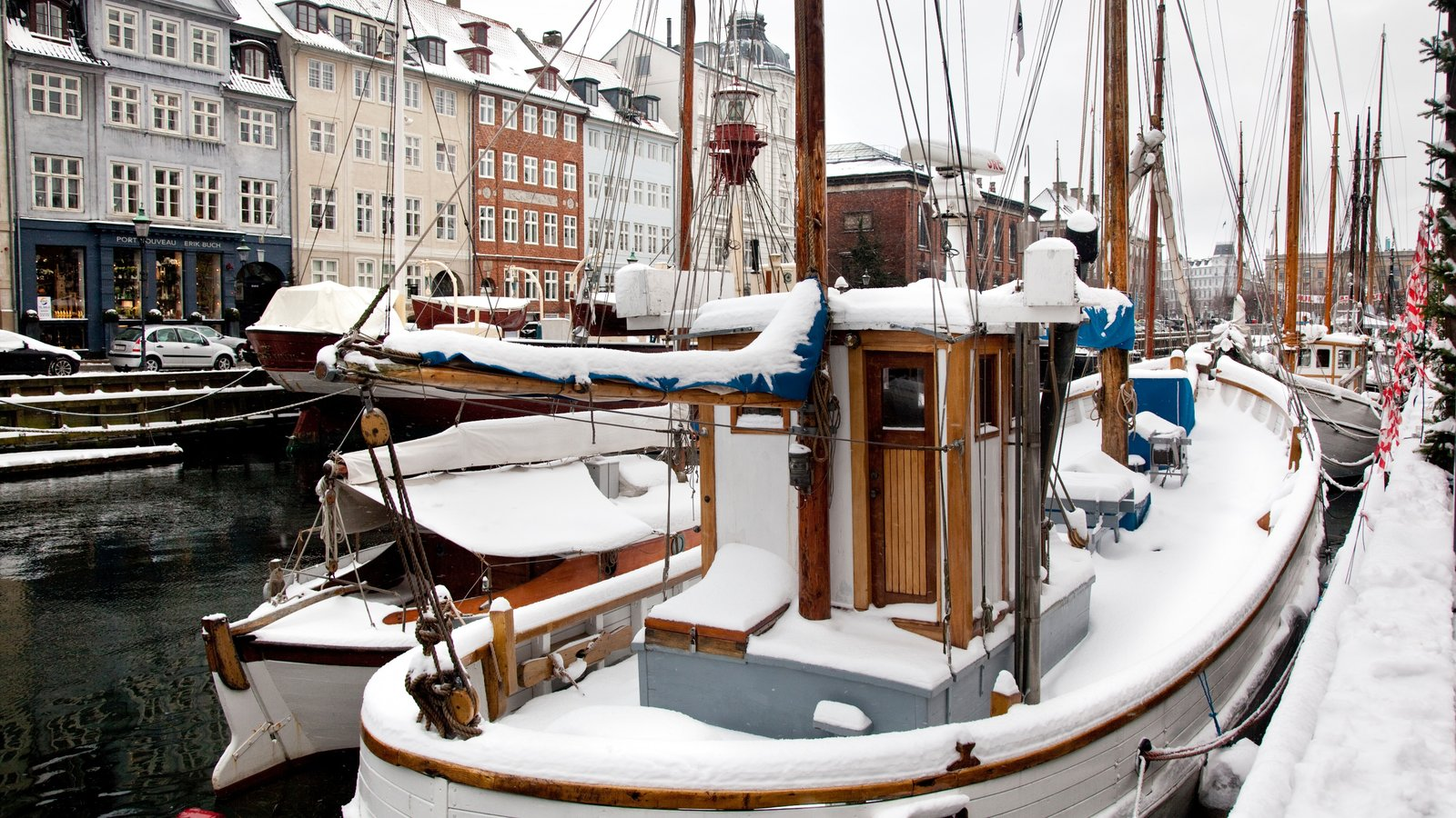 Nyhavn showing boating, snow and a marina