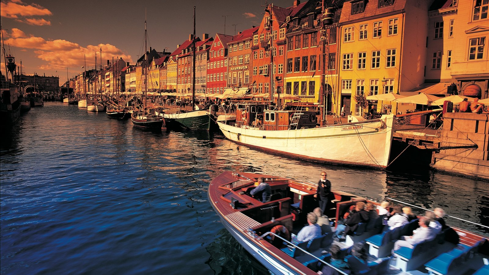 Nyhavn featuring a sunset, boating and a river or creek
