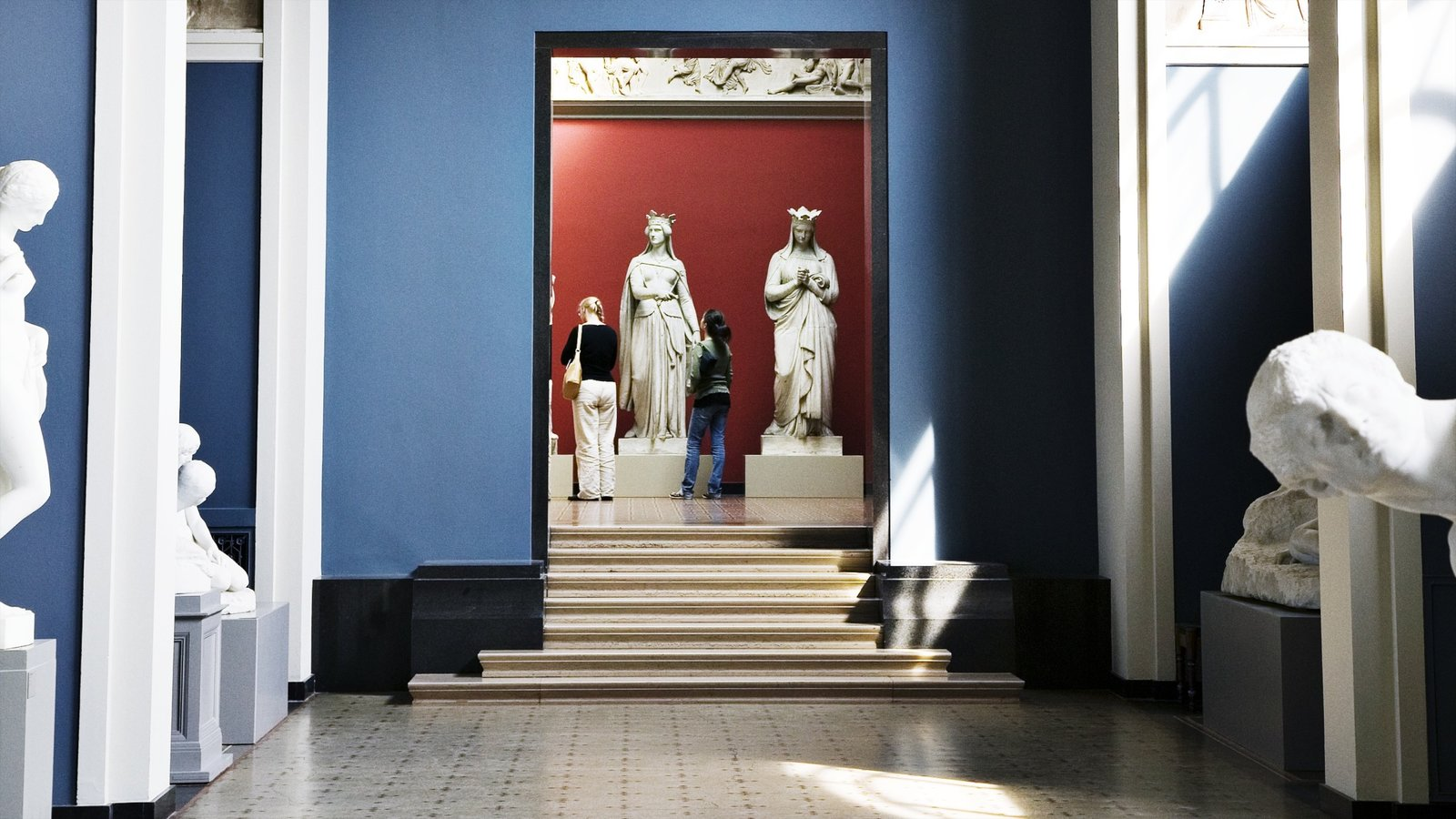 Ny Carlsberg Glyptotek which includes a statue or sculpture and interior views