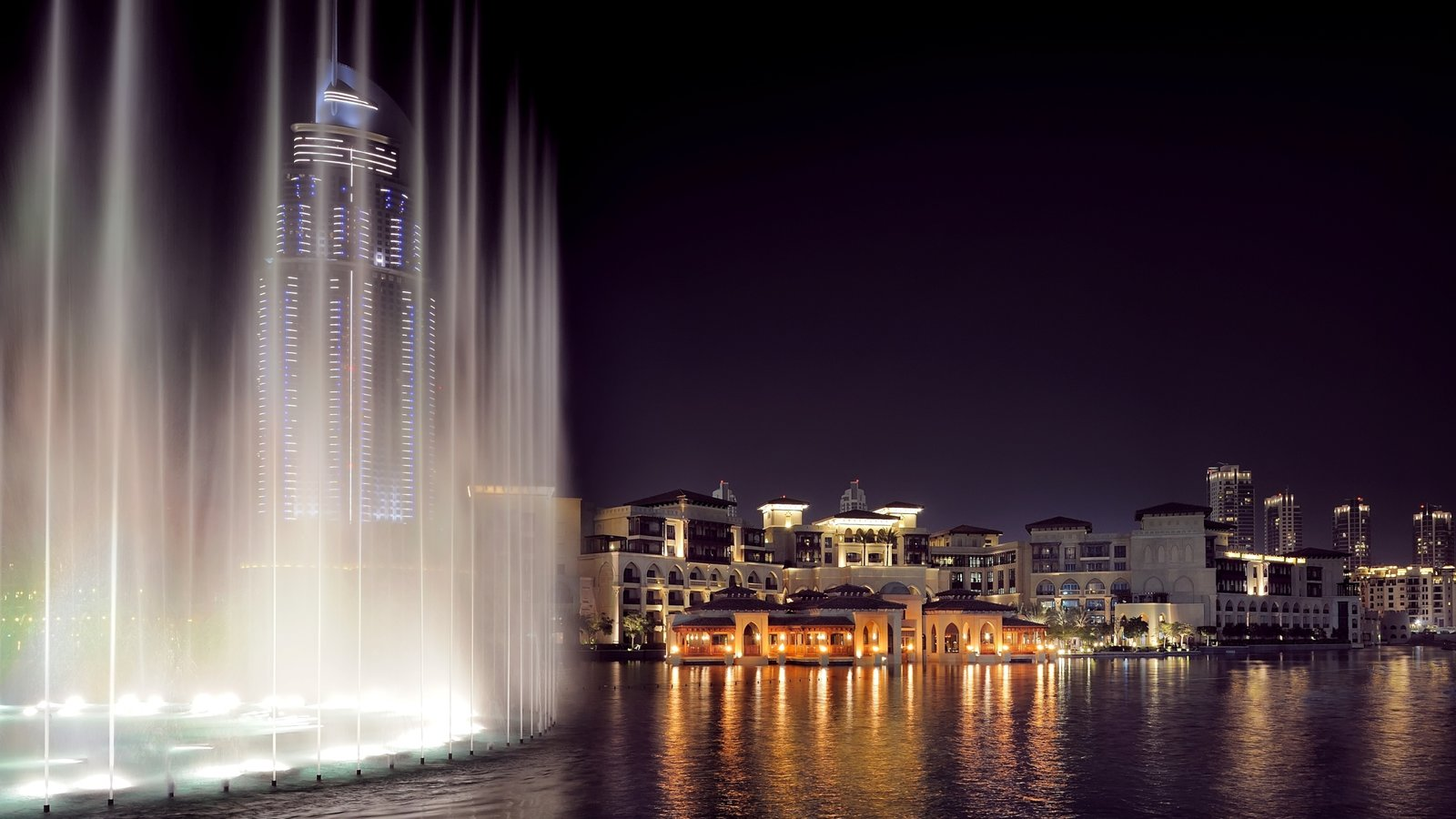 Dubai Emirate which includes a fountain, night scenes and a skyscraper