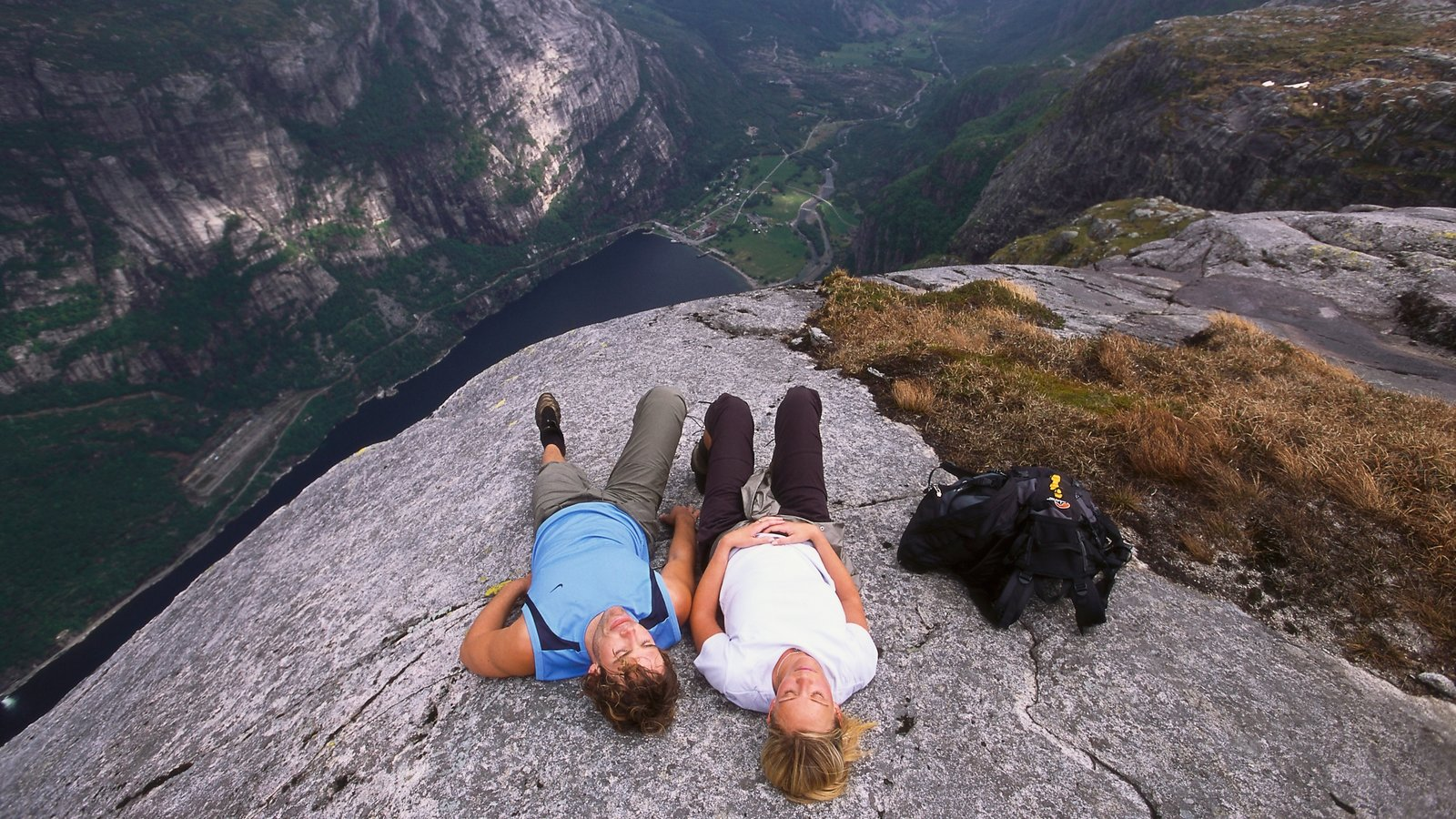 Kjerag which includes a gorge or canyon, mountains and hiking or walking