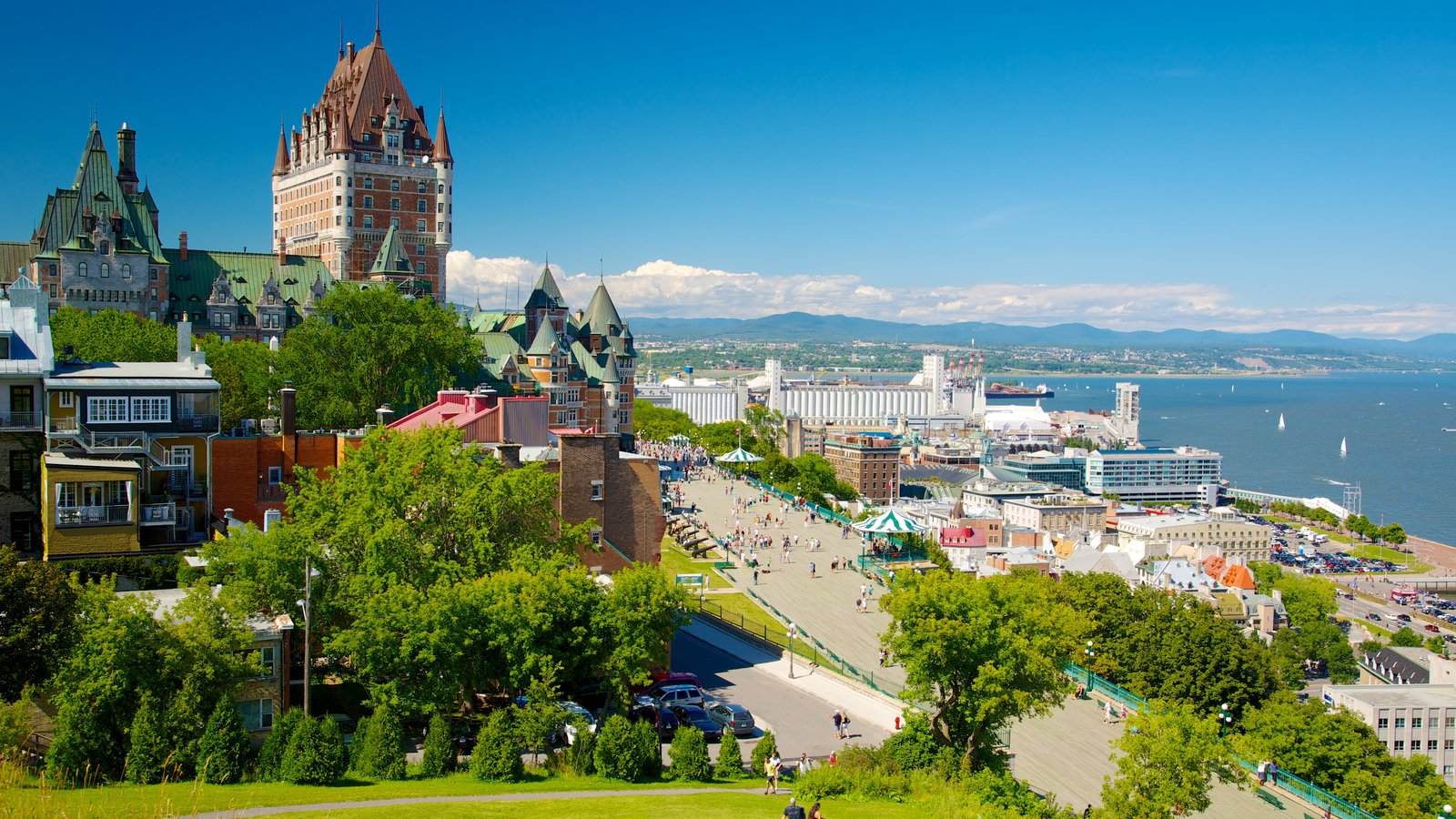 Parks Canada\'s Dufferin Terrace which includes landscape views, a castle and a city
