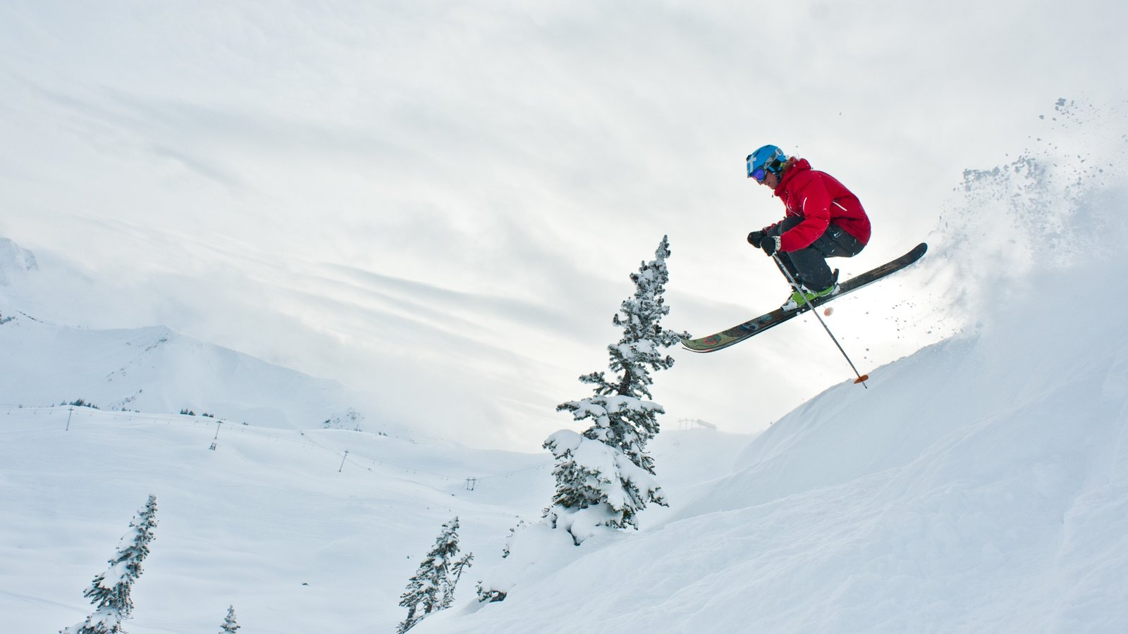 Whistler Ski Area showing snow skiing and snow as well as an individual male