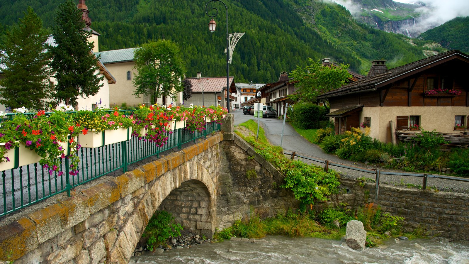 Argentiere which includes a small town or village, a bridge and a river or creek