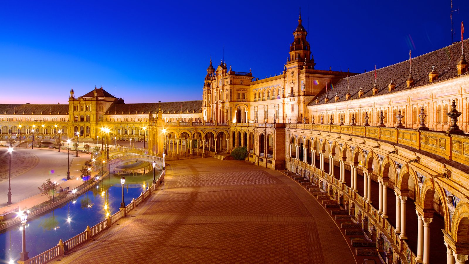 Plaza de Espana which includes a castle, heritage architecture and night scenes