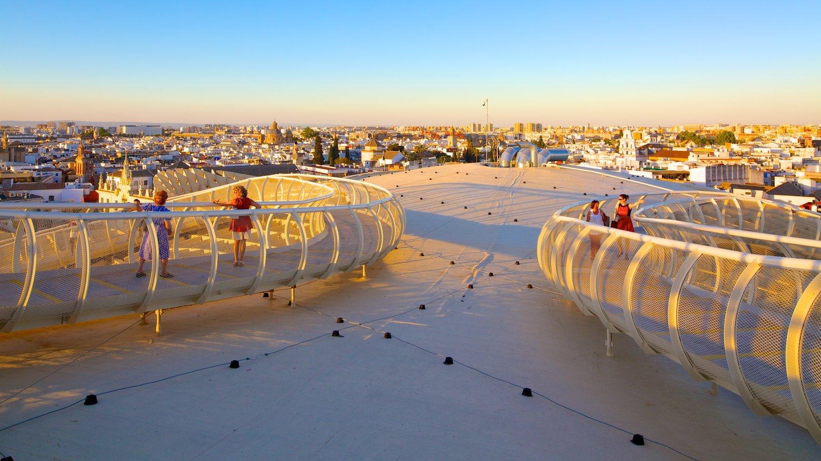Metropol Parasol que incluye una puesta de sol, arquitectura moderna y horizonte