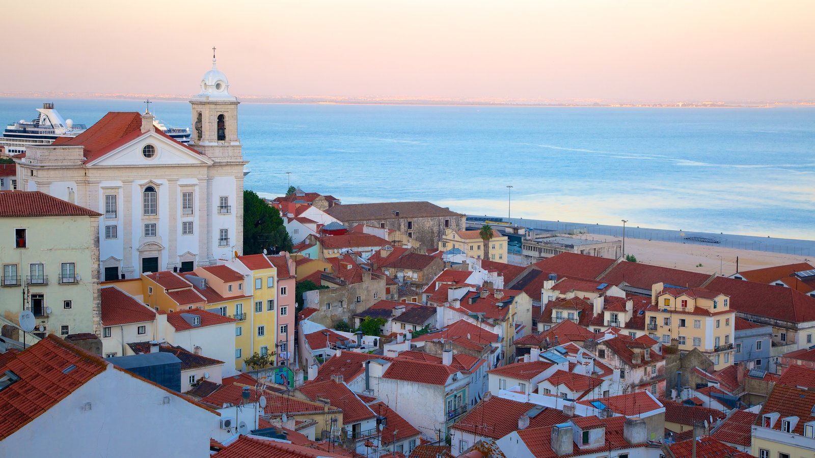 Alfama featuring a coastal town and a sunset