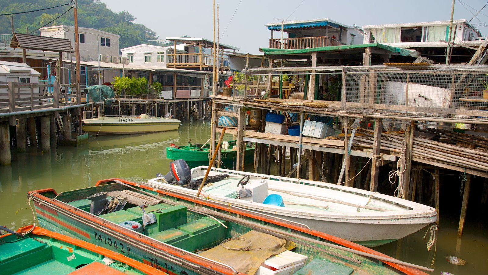 Tai O Fishing Village which includes a river or creek, boating and a house