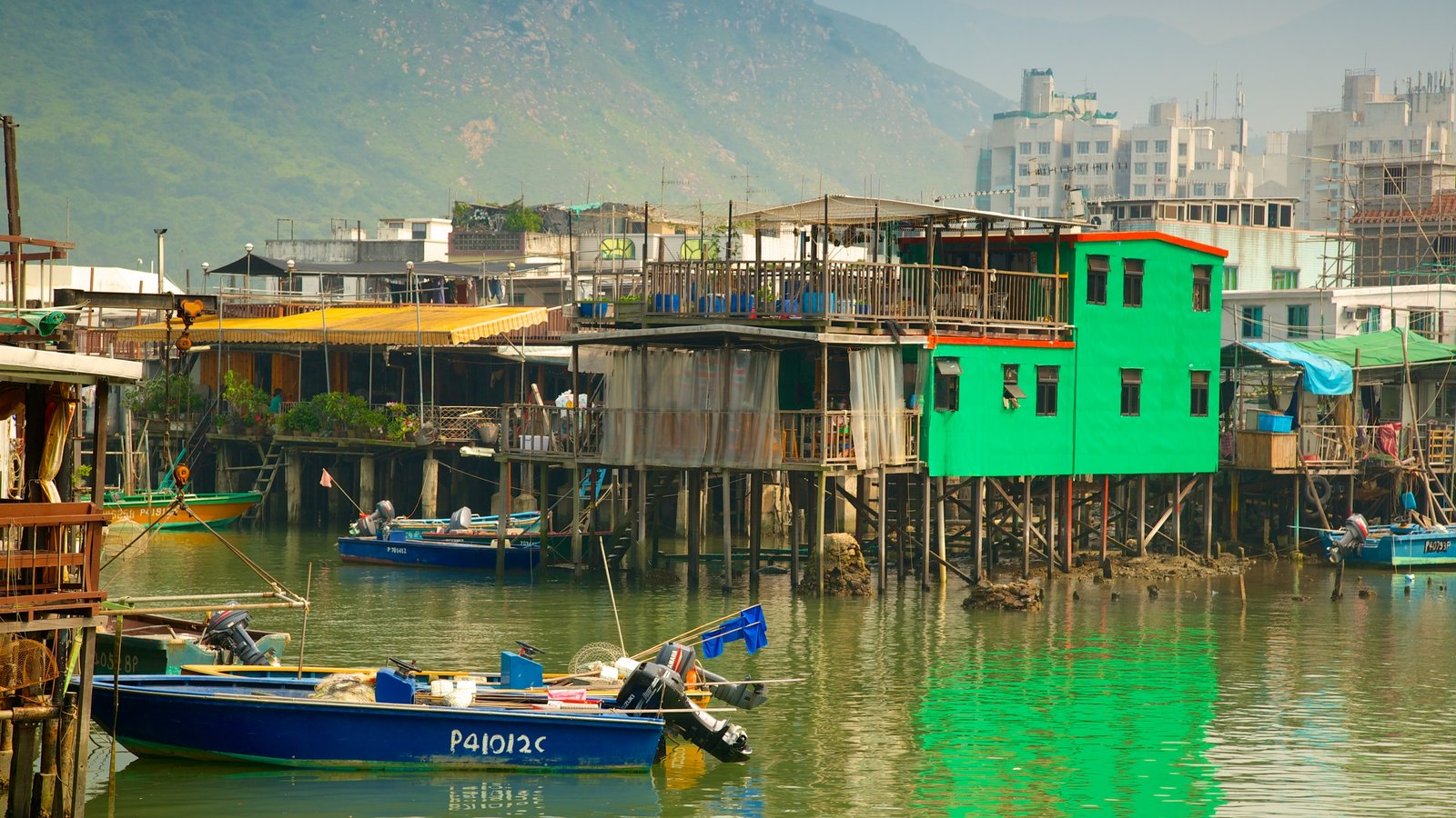 Tai O Fishing Village featuring a small town or village, a river or creek and a house